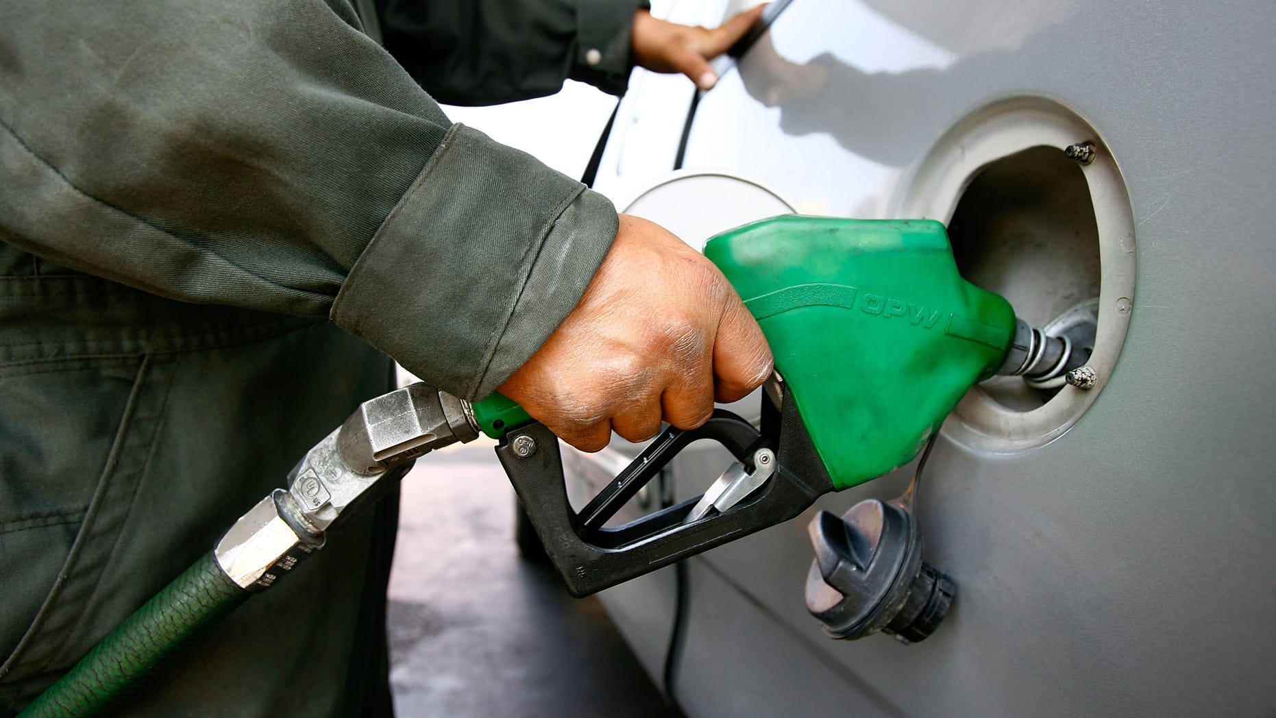 TIJUANA, MEXICO - JUNE 27:  A Pemex gas station attendant fills a car registered with a California license plate on June 27, 2008 in Tijuana, Mexico. With the cost of gasoline in California around $4.60 per gallon, many drivers are buying their fuel in Mexico for about $3.20. There is a price to pay for cheaper gas though. Mexican gas is formulated with more sulfur than California gas and that can damage the emission control equipment on US cars, causing them to fail emissions tests and leading to expensive repairs. In addition, unless a driver has other business in Mexico, part of their fuel savings will be burned up idling in a line that can easily last for hours to get back into the US.  (Photo by David McNew/Getty Images)