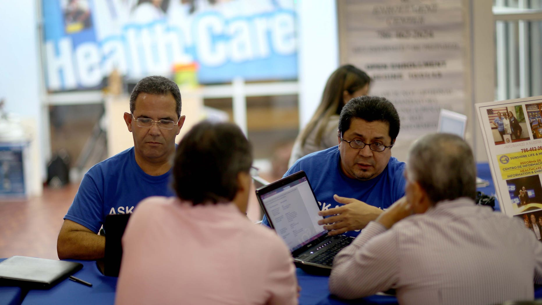 Insurance agents help people with the Affordable Care Act on November 5, 2013 in Miami, Florida.