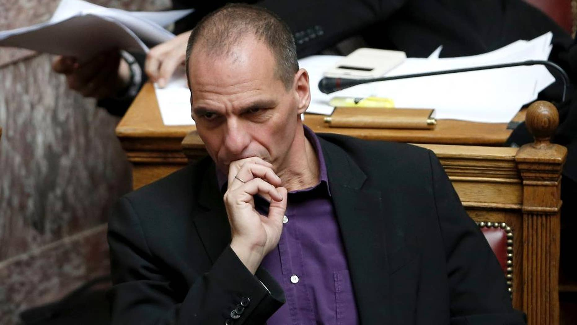Greek Finance Minister Yanis Varoufakis attends a parliament session before the vote of an anti-poverty bill, the first piece of legislation from the left-wing government, in Athens, on Wednesday, March 18, 2015. Tsipras insisted Wednesday his government will honor an election promise to end budget austerity — a note of defiance ahead of an expected meeting with the leaders of Germany and France on the country's troubled bailout. (AP Photo/Petros Giannakouris)