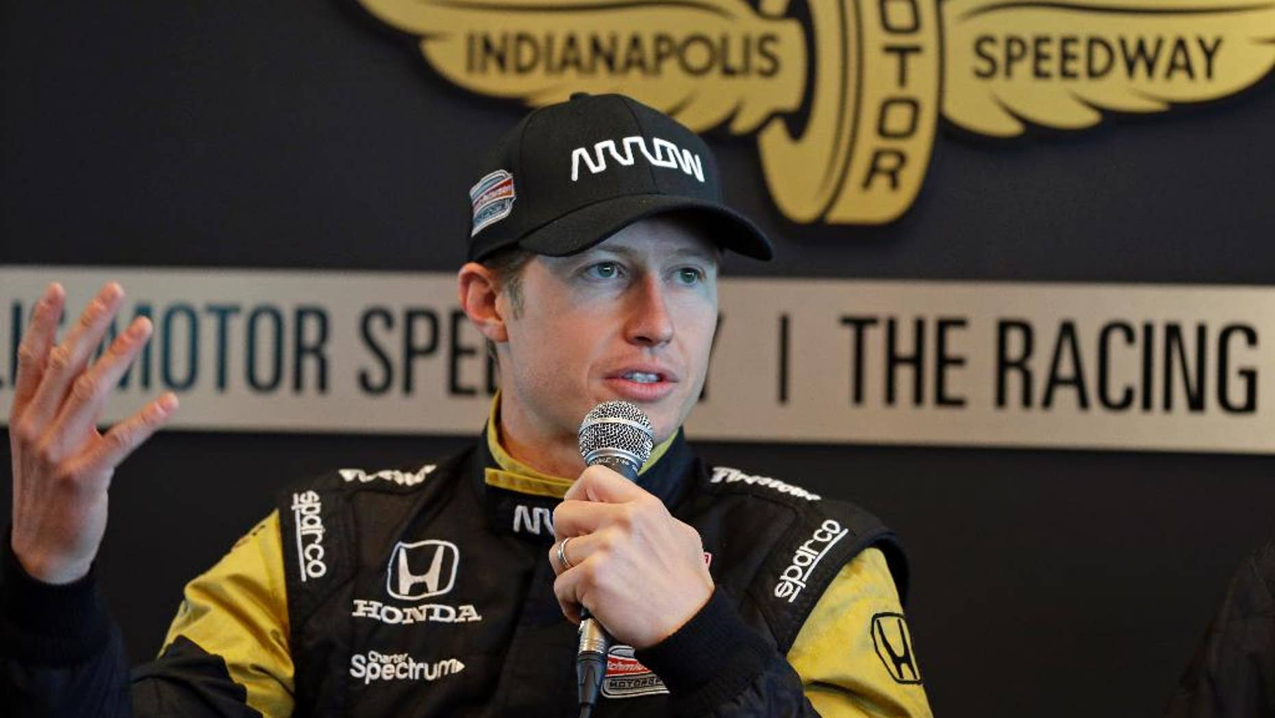 Ryan Briscoe, of Australia, answers a question about replacing James Hinchcliffe for the Indianapolis 500 auto race during a press conference at Indianapolis Motor Speedway in Indianapolis, Thursday, May 21, 2015. Hinchcliffe was injured in a crash on Monday. (AP Photo/Michael Conroy)