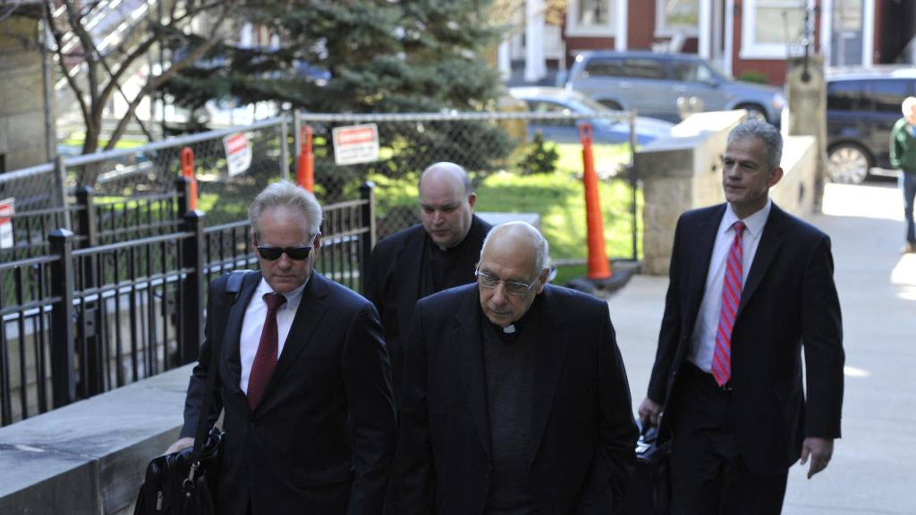 FILE - In this Thursday, April 14, 2016 file photo, attorneys lead Franciscans Giles Schinelli,  front, and Anthony Criscitelli to their hearing at the Blair County courthouse in Hollidaysburg, Pa. Testimony is set to resume in the case of three Franciscan friars charged with allowing a suspected sexual predator to teach at a Pennsylvania high school and hold other jobs where he molested more than 100 children. A preliminary hearing on Wednesday, April 27, 2016, will determine whether Schinelli, Robert D'Aversa and Criscitelli will stand trial on child endangerment and conspiracy charges.  (Todd Berkey/The Tribune-Democrat via AP, File) MANDATORY CREDIT