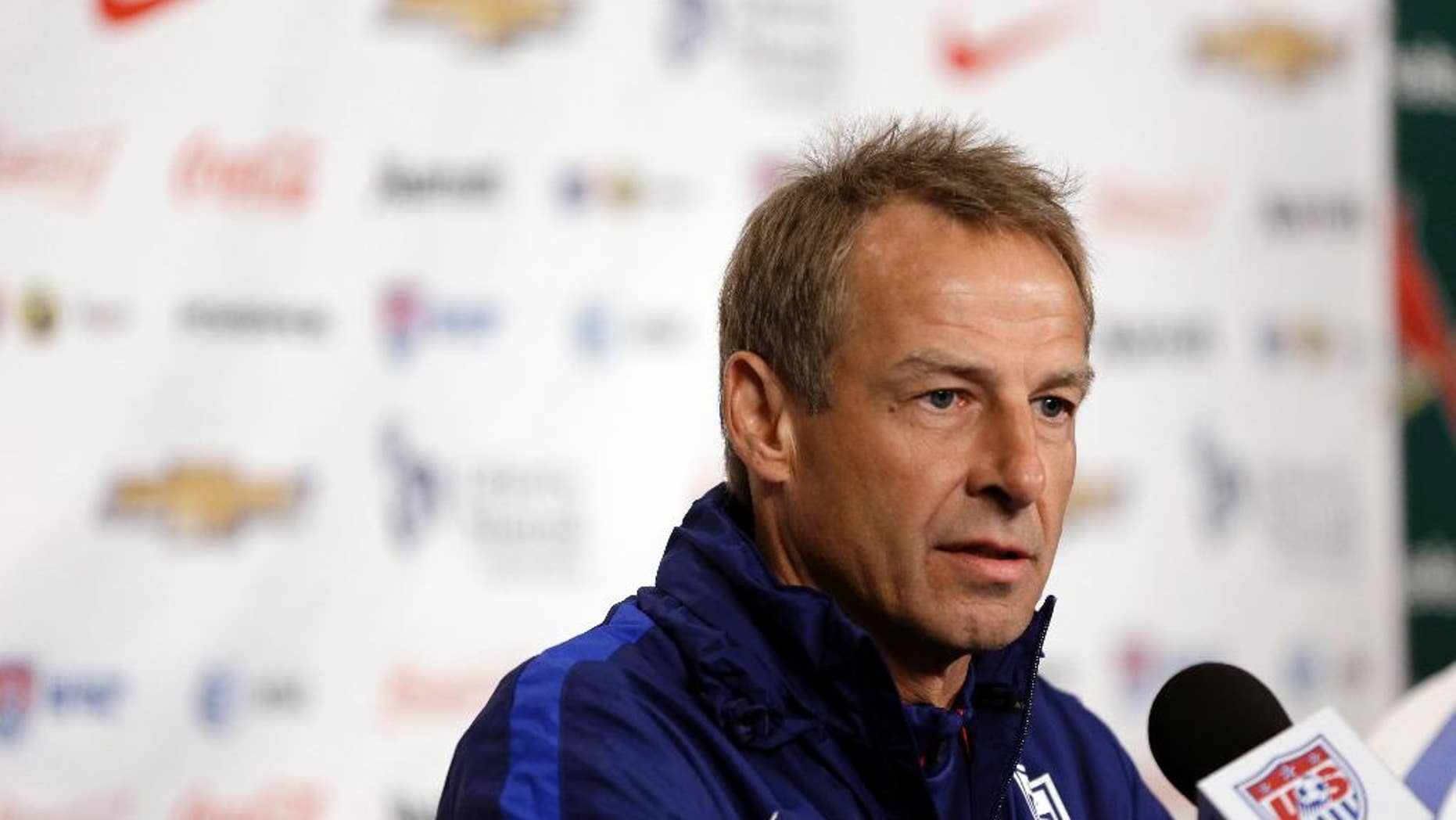 FILE - In this Nov. 12, 2015, file photo, U.S. men's soccer coach Jurgen Klinsmann takes part in a news conference in St. Louis. Klinsmann is proud of his half-decade in charge of the U.S. national team, and he believes he left successor Bruce Arena in a position to make the Americans even better. Klinsmann made his first public remarks since his firing when he spoke Friday at a convention of the National Soccer Coaches Association of America in Los Angeles. (AP Photo/Jeff Roberson, file)