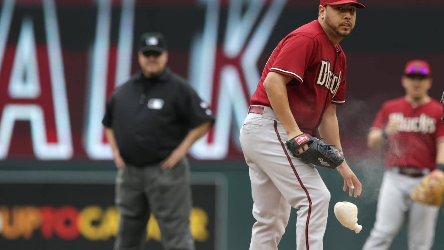 Arizona Diamondbacks' pitcher Vidal Nuno looks on after giving up a walk to Minnesota Twins' Kennys Vargas in the first inning of a baseball game, Wednesday, Sept. 24, 2014, in Minneapolis. Nuno gave up three walks in the first. (AP Photo/Jim Mone)