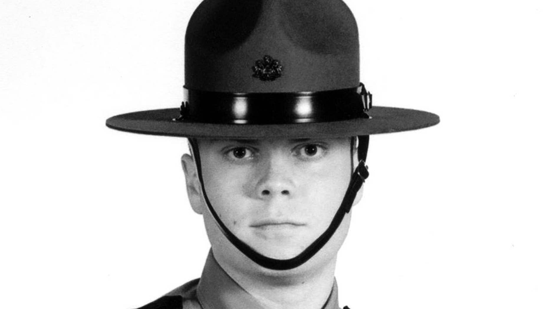 FILE - This undated file photo provided by the Pennsylvania State Police shows Trooper Alex Douglass. Douglass, wounded in the Sept. 12 shooting outside the Blooming Grove barracks that killed Cpl. Bryon Dickson, made his first public remarks Saturday, March 28, 2015, as the borough of Dunmore named a road after Dickson. Douglass, who walked with a cane, told reporters he feels good and no longer needs crutches to get around. He says he has had 16 surgeries with one more scheduled next month. (AP Photo/Pennsylvania State Police, File)