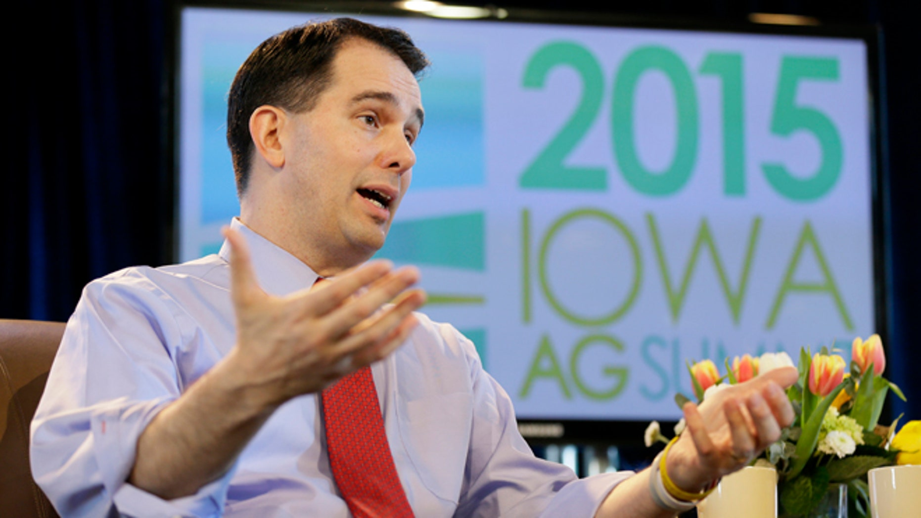 FILE - In this March 7, 2015 file photo, Wisconsin Gov. Scott Walker speaks during the Iowa Agriculture Summit in Des Moines, Iowa.  Known for his accessibility and willingness to always be available to take questions, even after the most routine appearances, Walker has suddenly become much harder to reach as he ramps up for a likely 2016 presidential campaign and deals with a series of flubs and shifts in position on hot button issues. (AP Photo/Charlie Neibergall)