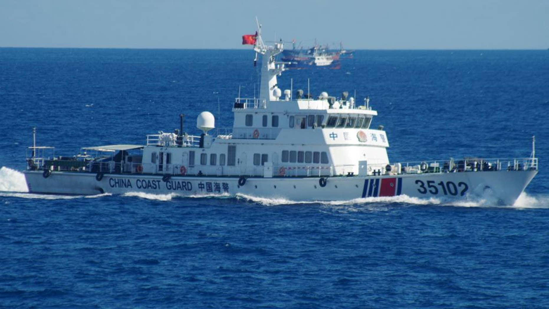 In this photo released by the 11th Regional Coast Guard Headquarters of Japan, a Chinese coast guard vessel sails near disputed East China Sea islands Saturday, Aug. 6, 2016. Japan's Foreign Ministry said in a statement it filed the protest after Japan's coast guard spotted the vessels Saturday along with a fleet of 230 Chinese fishing boats swarming around the Japanese-controlled Senkaku Islands. China also claims the islands, calling them the Diaoyu. (11th Regional Coast Guard Headquarters via AP)