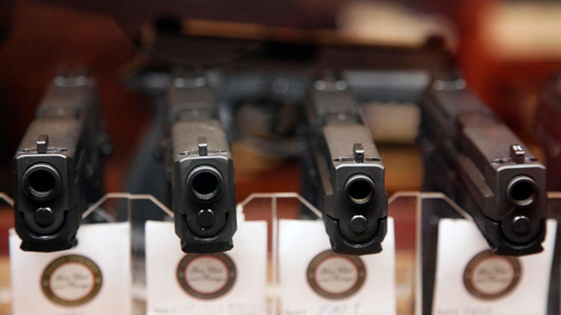 FILE: Handguns are displayed.