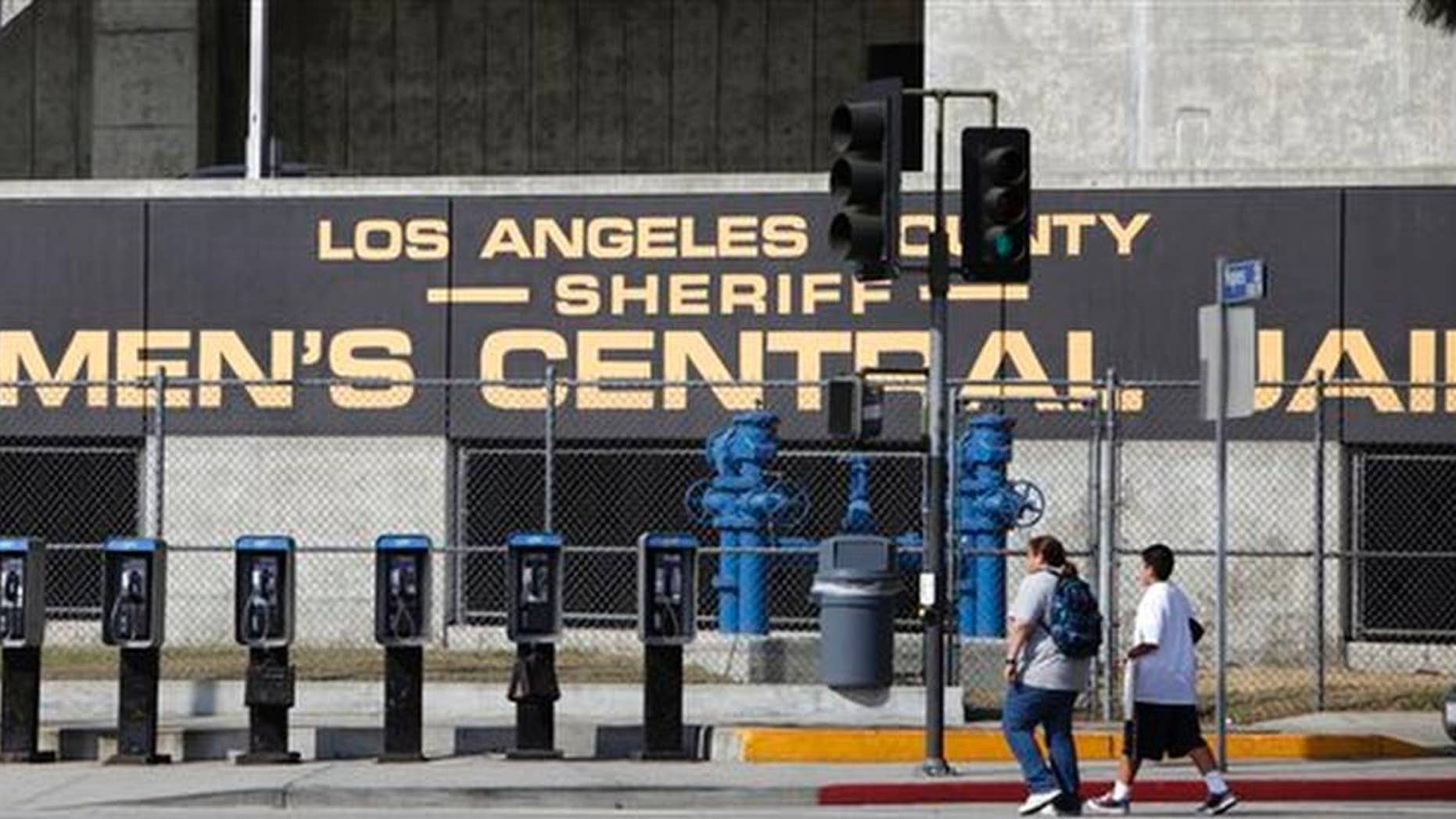 This Wednesday, Sept. 28, 2011 photo shows the Los Angeles County Sheriff's Men's Central Jail facility in Los Angeles. The number of arrests by police in California has plunged in recent years, but that doesn't necessarily represent good news on crime, according to an analysis published Saturday, April 1. The state saw 1.5 million arrests for misdemeanors and felonies in 2015, the most recent year with figures available, according to the Los Angeles Times. (AP Photo/Damian Dovarganes, File)