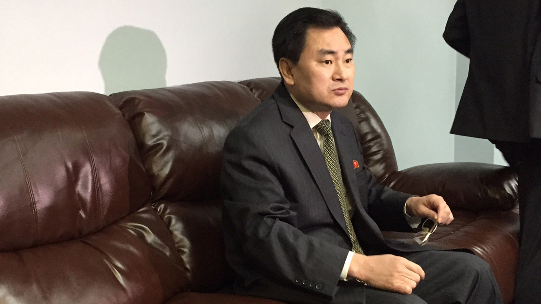 """North Koreaâs deputy permanent representative to the United Nations, An Myong Hun, waits to speak to reporters at North Koreaâs U.N. mission in New York, Wednesday April 8, 2015. Hun said Mexico has """"forcibly detained"""" one of its ships months after it ran aground off Mexico's Gulf coast and that his country will take unspecified """"necessary measures to make the ship leave immediately."""" An Myong Hun said the ship, the Mu Du Bong, was not carrying anything prohibited by U.N. sanctions and that more than 50 crew remain on board. (AP Photo/Cara Anna)"""