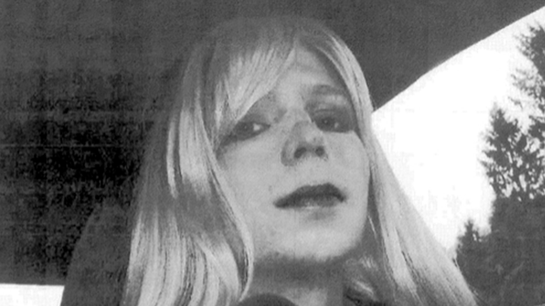"""In this undated photo provided by the U.S. Army, Pfc. Chelsea Manning poses for a photo wearing a wig and lipstick. Manningemailed his militarytherapist the photo with a letter titled, """"My problem,"""" in which he described his issues with gender identity and his hope that a military career would """"get rid of it."""" (AP/U.S. Army)"""