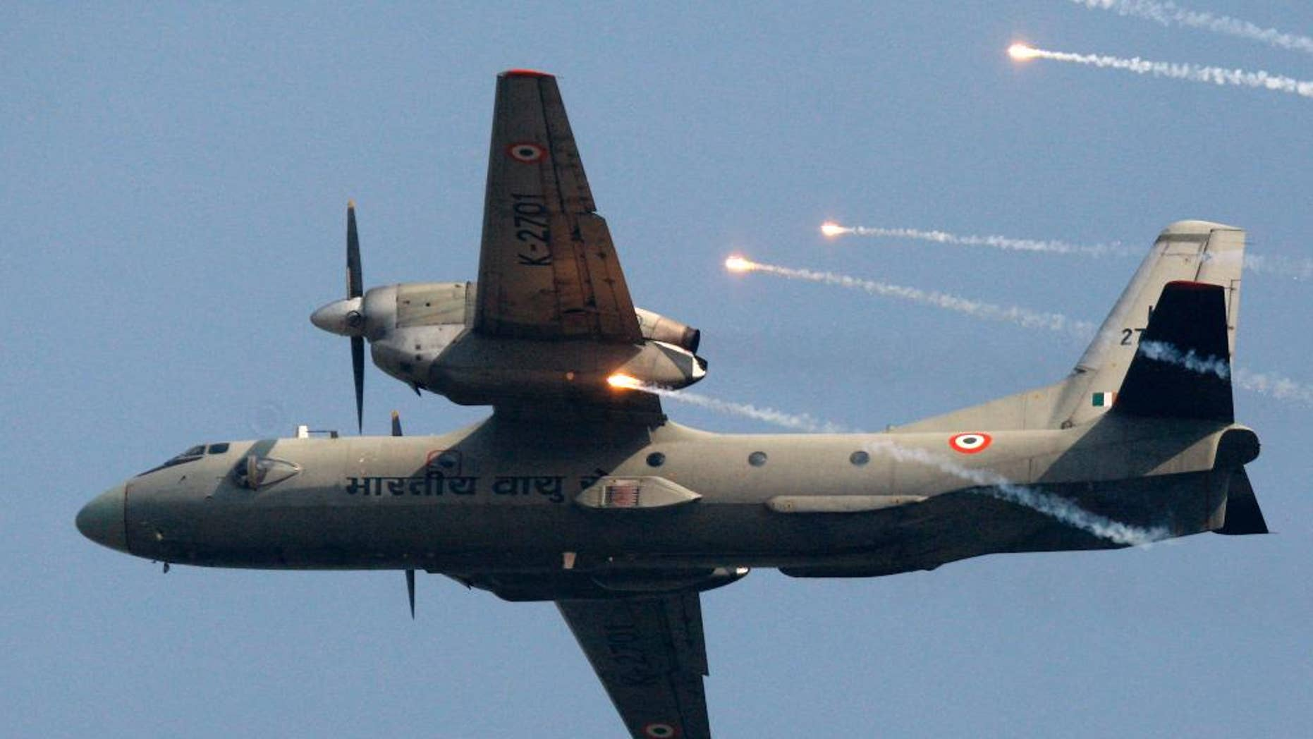 FILE- In this Thursday, Oct. 8, 2009, file photo, an Indian Air Force's (IAF) AN-32 transport aircraft releases chaff as it flies past the IAF Day Parade in New Delhi, India. A spokesman for India's defense ministry says the Indian air force has lost contact with a transport plane AN-32 with 29 people on board. A massive search by the air force, navy and coast guard has been launched. (AP Photo/Mustafa Quraishi, file)