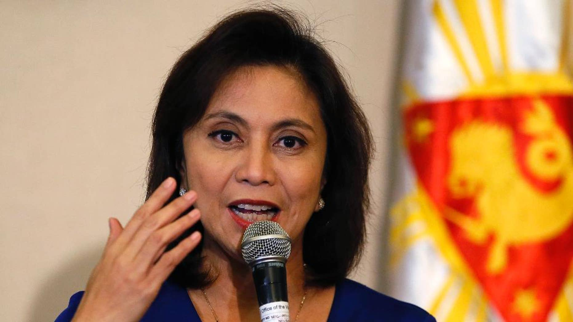 "FILE - In this Dec. 5, 2016 file photo, Philippine Vice President Leni Robredo answers questions from the media during a news conference following her resignation from her cabinet post under President Rodrigo Duterte in suburban Quezon city, south of Manila, Philippines. The Philippine vice president has raised alarms over the president's bloody crackdown against illegal drugs, which she says can't be solved ""with bullets alone,"" and she also asked Filipinos to ""defy brazen incursions on their rights.""  The comments are one of Robredo's sharpest critiques so far of President Rodrigo Duterte's campaign and are likely to antagonize him because they are intended for an international forum of human rights advocates, whom he has often lambasted.  (AP Photo/Bullit Marquez, File)"
