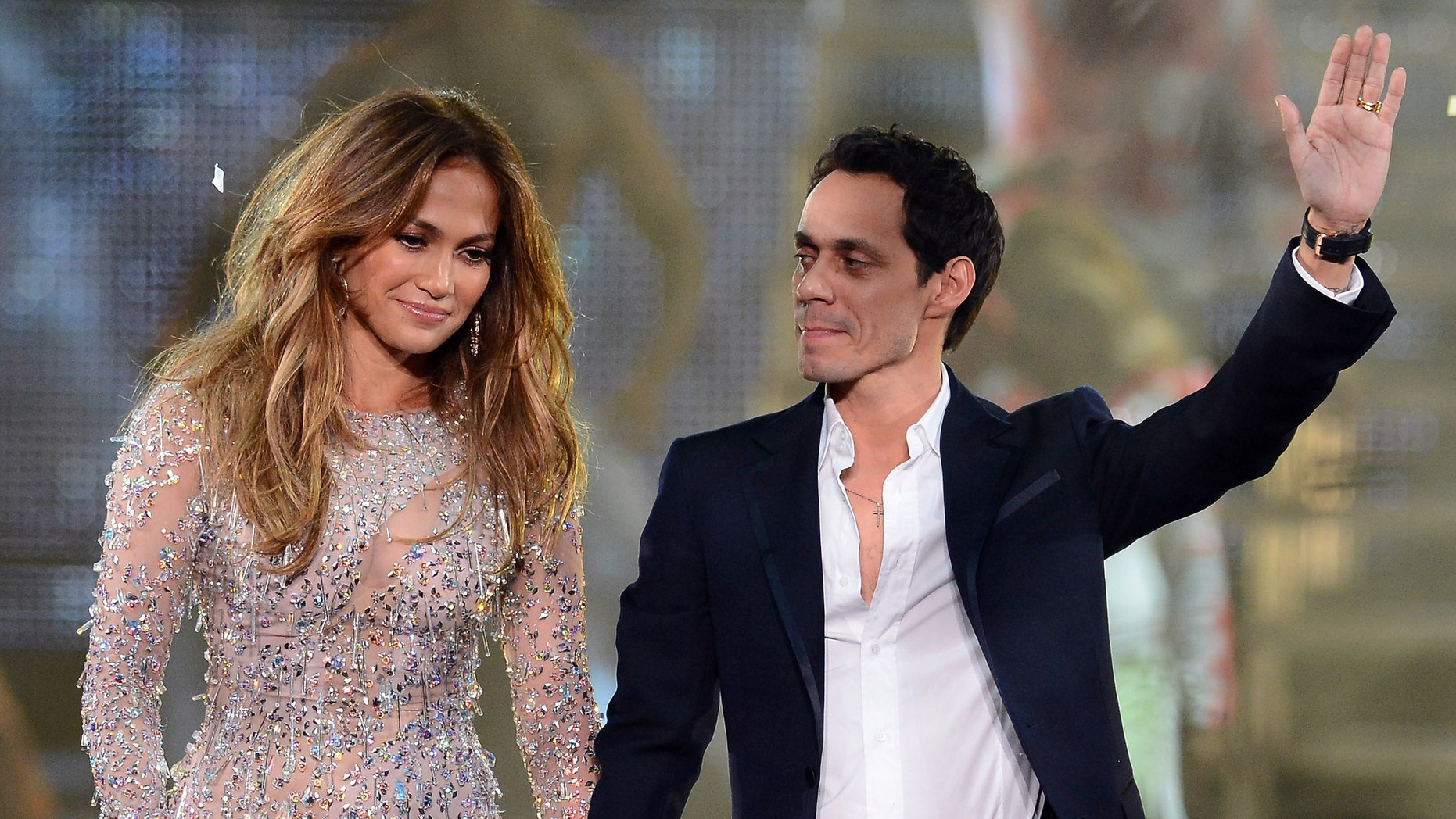 LAS VEGAS, NV - MAY 26:  Singer/actress Jennifer Lopez (L) and singer Marc Anthony appear during the finale of the Q'Viva! The Chosen Live show at the Mandalay Bay Events Center on May 26, 2012 in Las Vegas, Nevada.  (Photo by Ethan Miller/Getty Images)