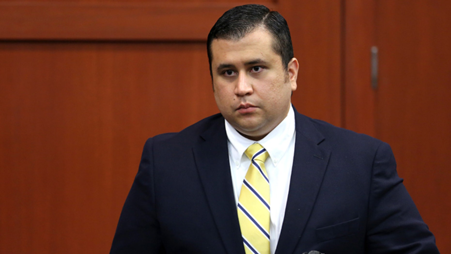 George Zimmerman leaves the courtroom on recess during  the 15th day of his murder trial in Seminole circuit court June 28, 2013 in Sanford, Florida.  (Photo by Joe Burbank-Pool/Getty Images)