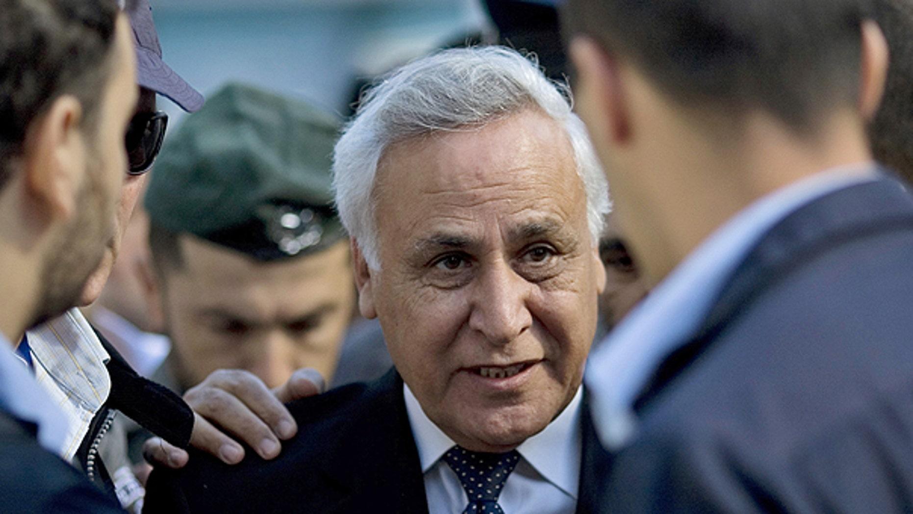 March 22: Former Israeli President Moshe Katsav, center, arrives at a court in Tel Aviv.