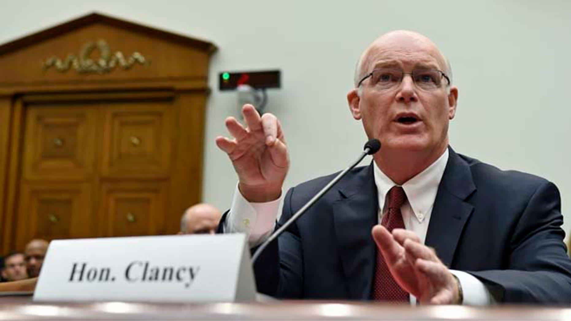 Acting Secret Service Director Joseph Clancy testifies on Capitol Hill in Washington, Wednesday, Nov. 19, 2014.