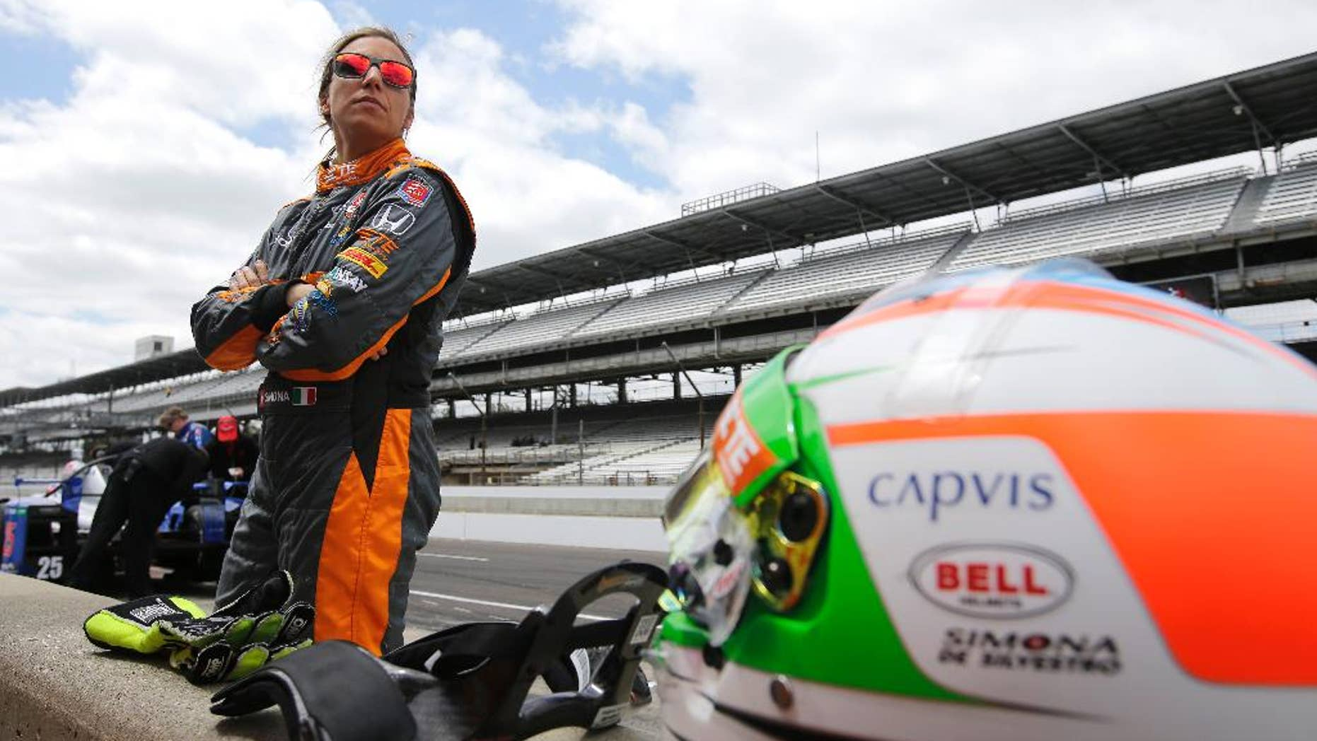 Driver Simona de Silvestro, of Switzerland, watches during practice for the Indianapolis 500 auto race at Indianapolis Motor Speedway in Indianapolis, Tuesday, May 12, 2015.  (AP Photo/Darron Cummings)
