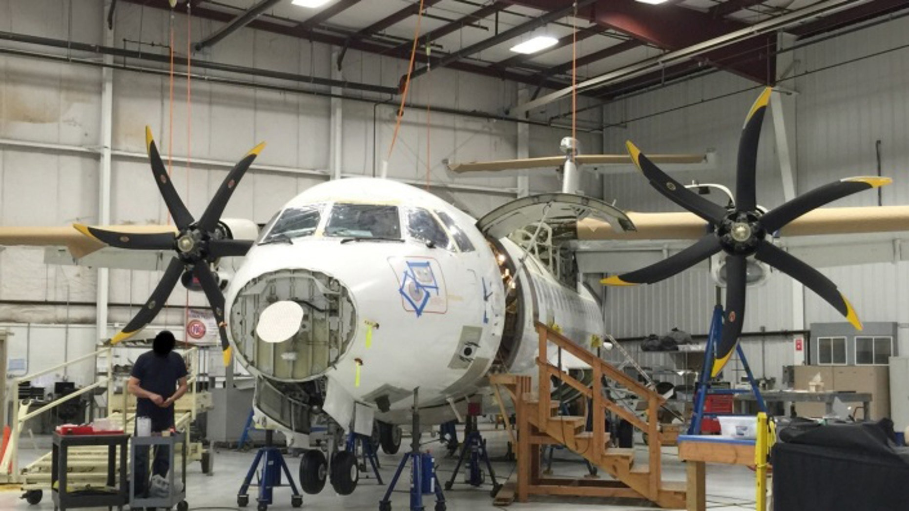 This photo provided by the Justice Department, taken in April 2015, shows a Drug Enforcement Agency (DEA) ATR 42-500 at the Defense Department's subcontractor's facility. A specialized plane at the DEA to fly missions in Afghanistan that has cost taxpayers $86 million has remained grounded for seven years. The Justice Department inspector general issued a scathing audit Wednesday, March 30, 2016, spurred by a July 2014 whistleblower's report. (Justice Department via AP)