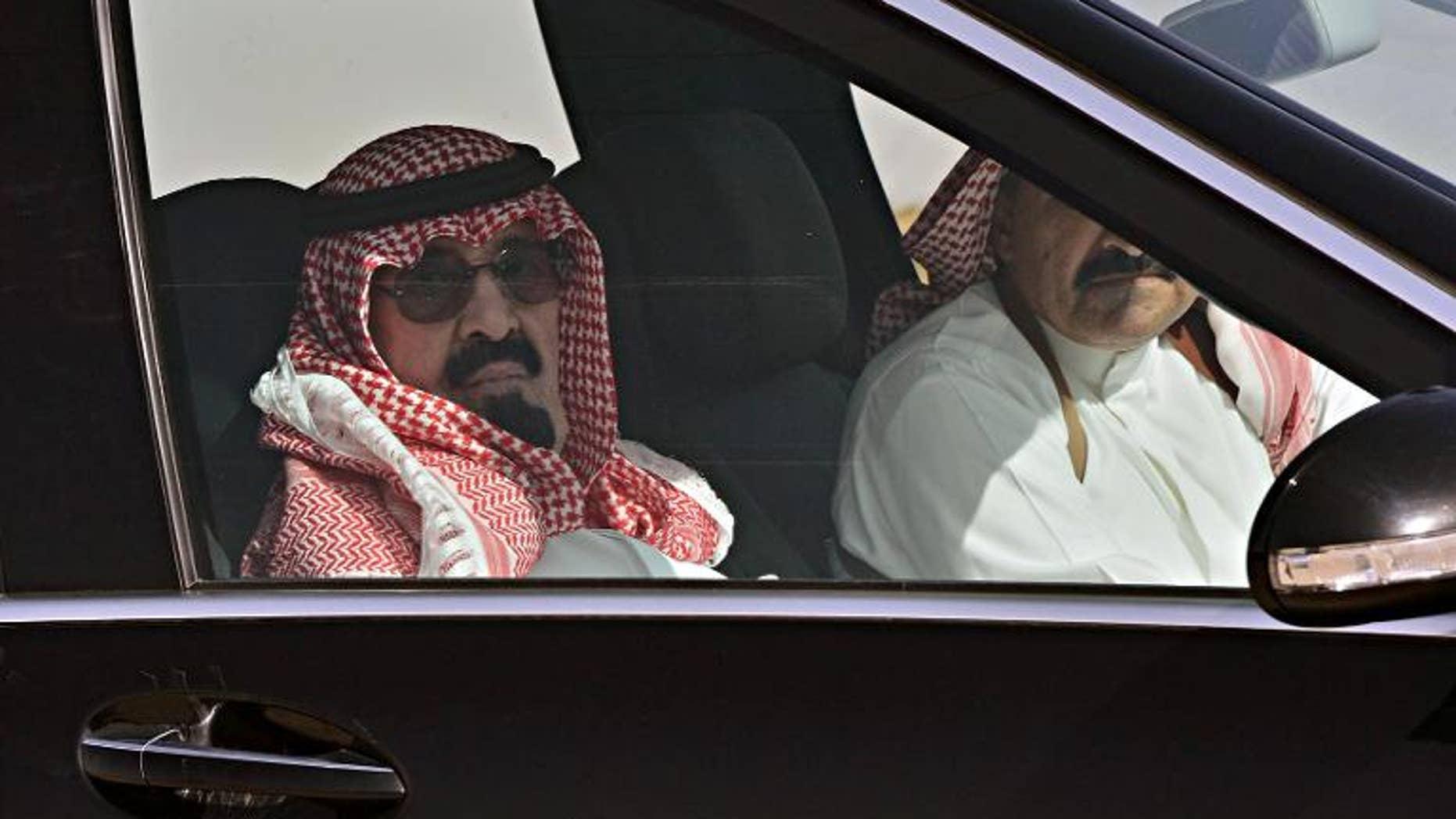 A picture released on March 3, 2013 shows King Abdullah bin Abdulaziz al-Saud arriving at Rawdat al-Khuraim to visit his farm