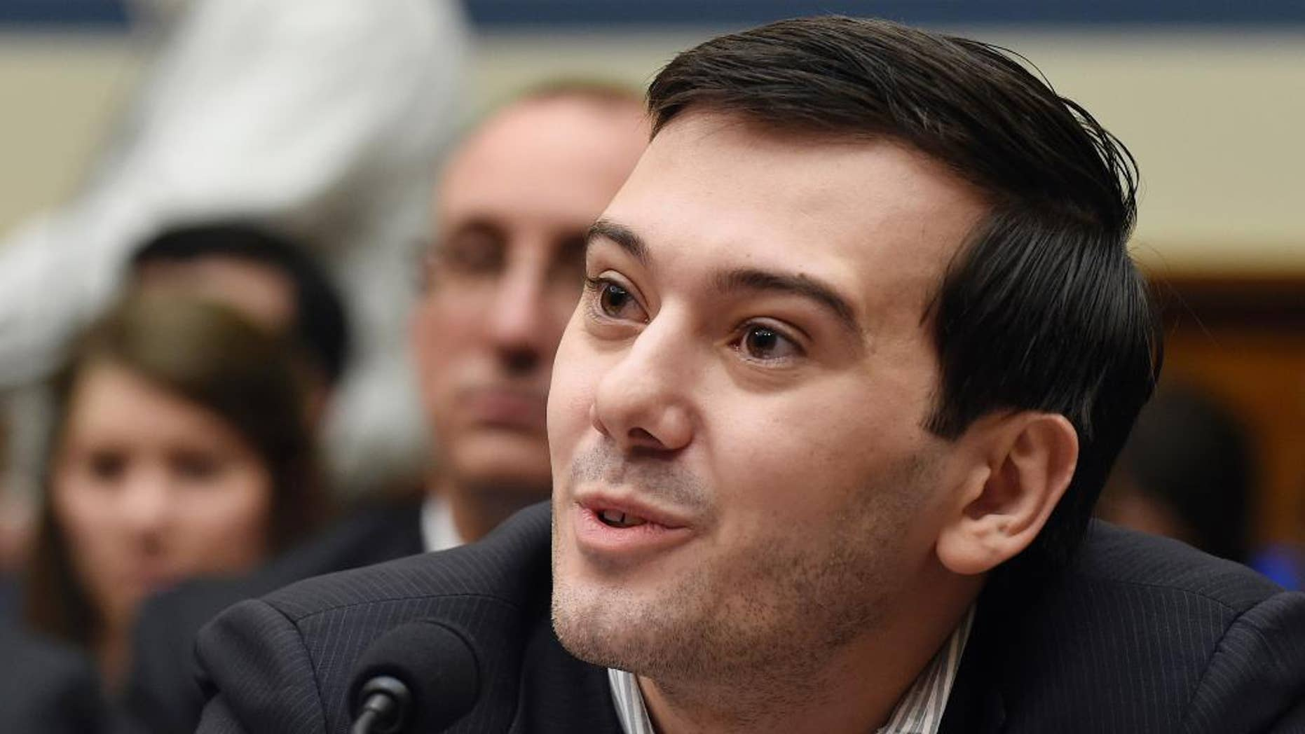 "FILE - In this Feb. 4, 2016 file photo, pharmaceutical chief Martin Shkreli speaks on Capitol Hill in Washington during the House Committee on Oversight and Reform Committee hearing on a decision by his former company, Turing Pharmaceuticals, to significantly raise the price of the anti-parasitic medication Daraprim. Heated protests at the University of California, Davis brought the cancellation of planned speeches by far-right commentator Milo Yiannopoulos and former pharmaceutical executive Shkreli shortly before the event was to begin. University police put up barricades as protesters shouting ""shut it down"" grew increasingly rowdy in the hours leading up to the talks on Friday night, Jan. 13, 2017. (AP Photo/Susan Walsh, File)"