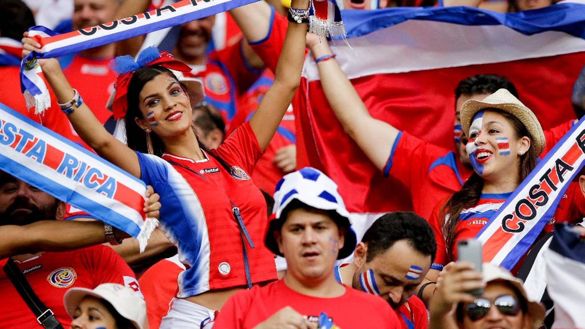 Costa Rican fans react before the World Cup quarterfinal soccer match between the Netherlands and Costa Rica at the Arena Fonte Nova in Salvador, Brazil, Saturday, July 5, 2014. (AP Photo/Matt Dunham)