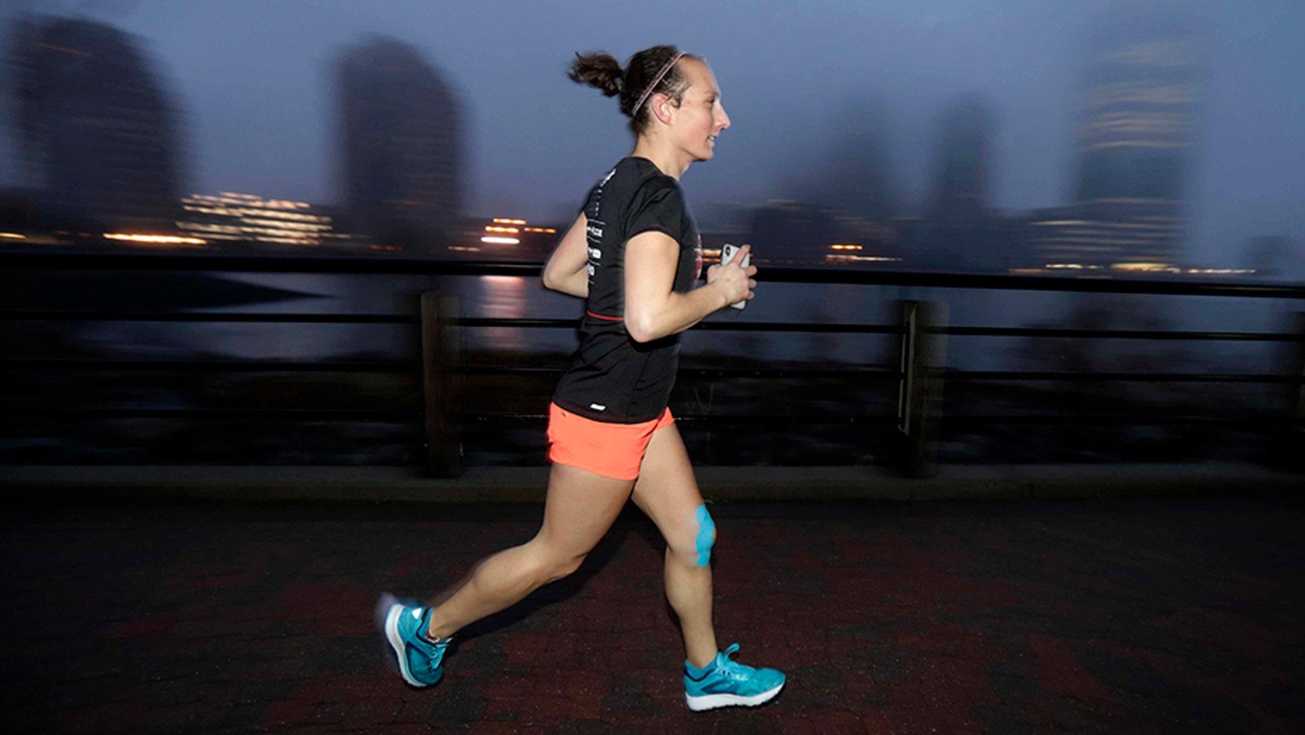 Amelia Gapin, a trangender woman, works out while preparing to run the Boston Marathon.