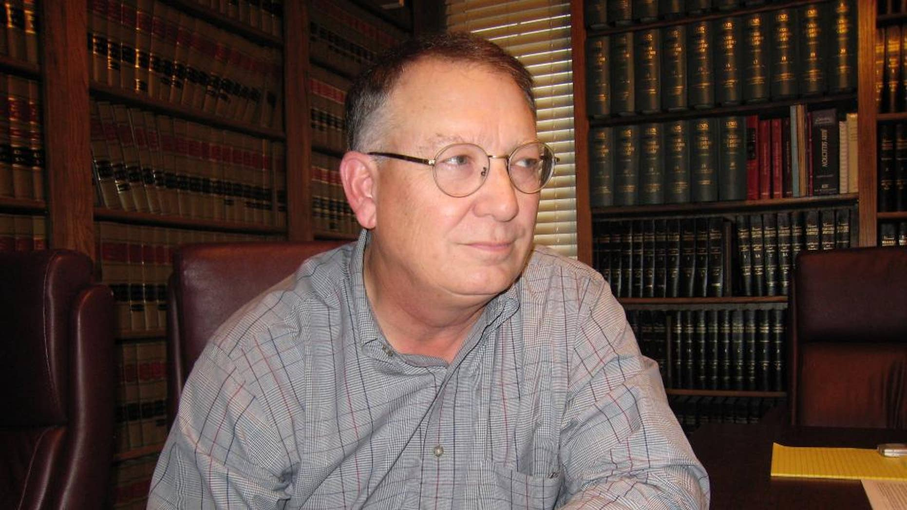FILE - In this Oct. 13, 2009, file photo, John Jackson, the prosecutor in the 1992 trial of Cameron Todd Willingham, poses for a photo in Austin, Texas. Jackson, who handled the case of Willingham who was executed for the fire deaths of his three daughters has been formally accused of misconduct over allegations that he concealed evidence during the murder trial. He declined comment Wednesday, March 18, 2015, on the accusations against him and referred questions to an attorney. (AP Photo/Austin American-Statesman, W. Gardner Selby, File)