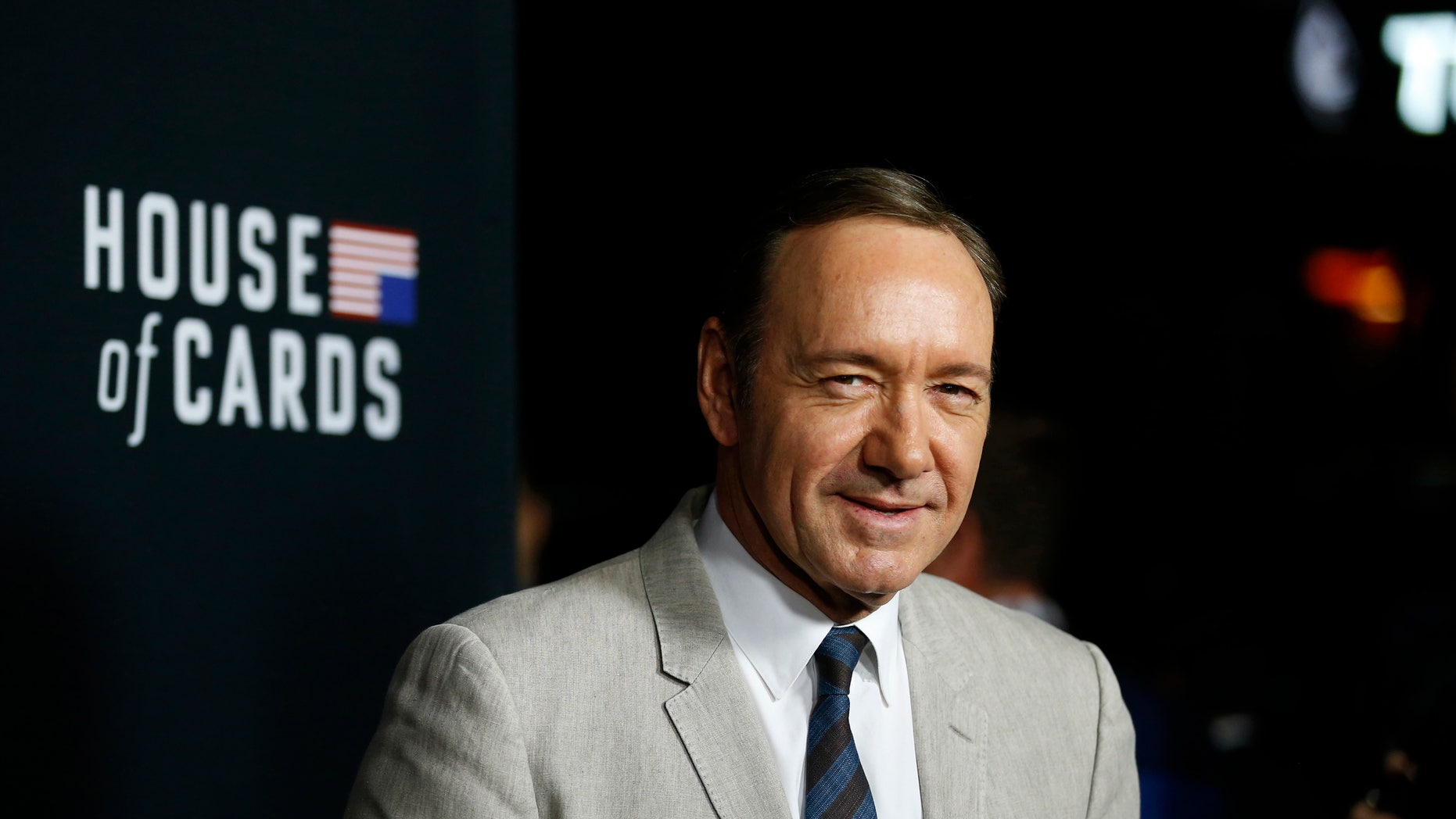 """February 13, 2014. Cast member Kevin Spacey poses at the premiere for the second season of the television series """"House of Cards"""" in Los Angeles."""