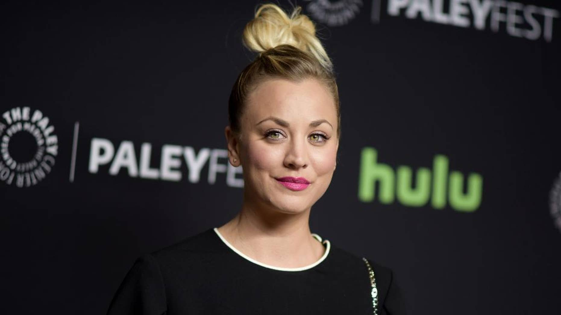 """FILE - In this March 16, 2016, file photo, Kaley Cuoco attends the 33rd Annual Paleyfest: """"The Big Bang Theory"""" held at the Dolby Theatre in Los Angeles. Cuoco has apologized for posting a photo on July 4, 2016, of her dogs sitting on an American flag. (Photo by Richard Shotwell/Invision/AP, File)"""