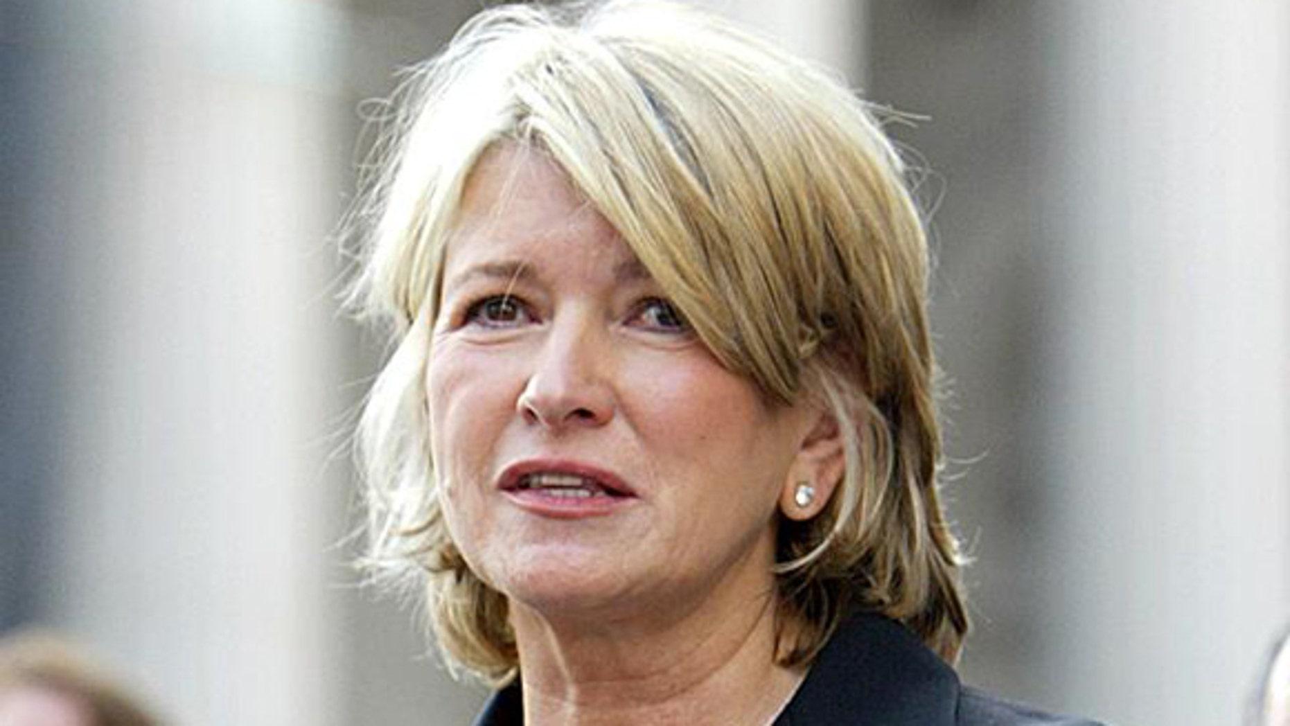 Martha Stewart reads a statement after sentencing at Manhattan federal court, Friday July 16, 2004, in New York.