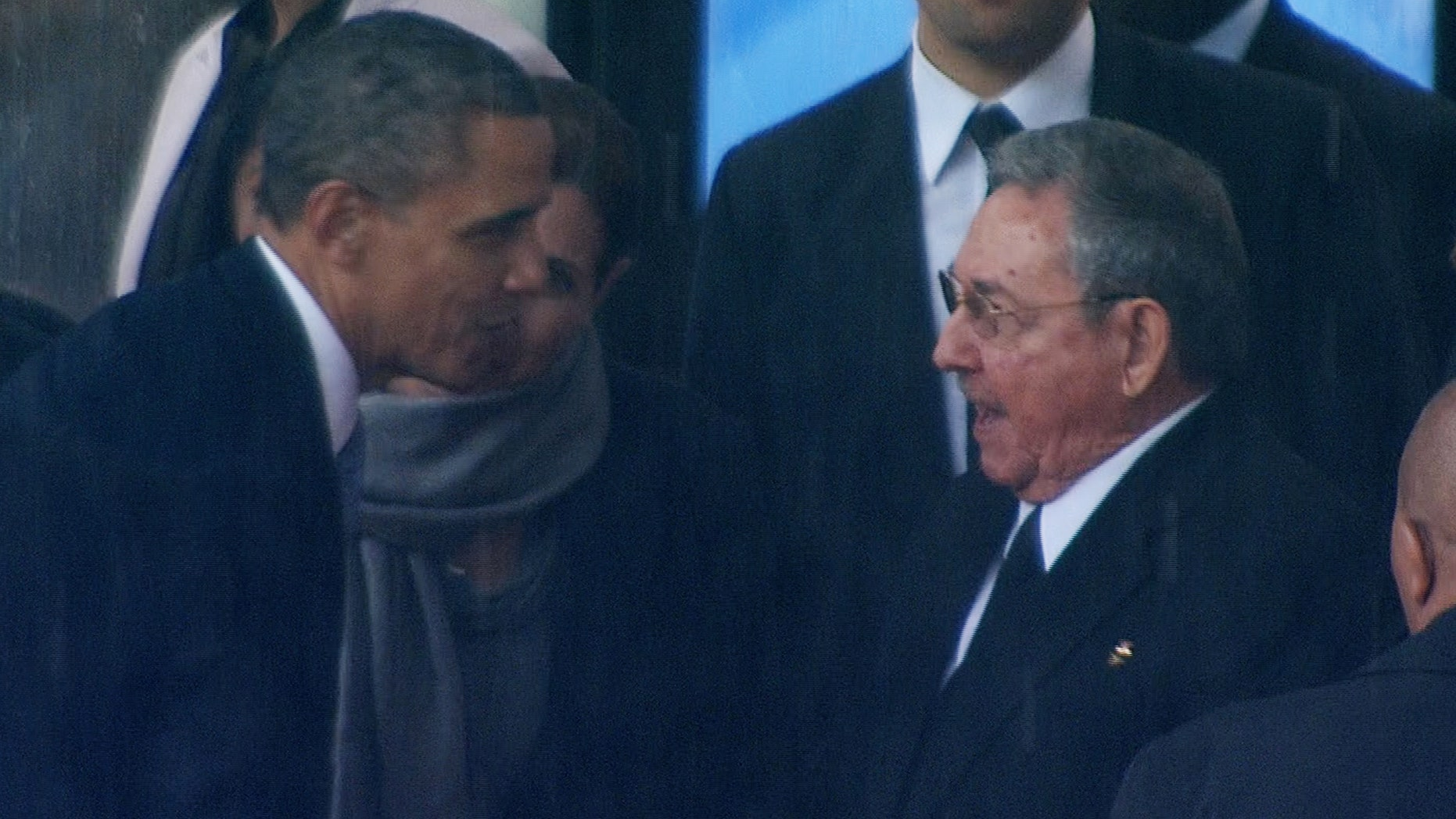 President Obama shakes hands with Cuban President Raul Castro at the FNB Stadium in Soweto, South Africa, during a memorial service for former South African President Nelson Mandela, Tuesday Dec. 10, 2013.