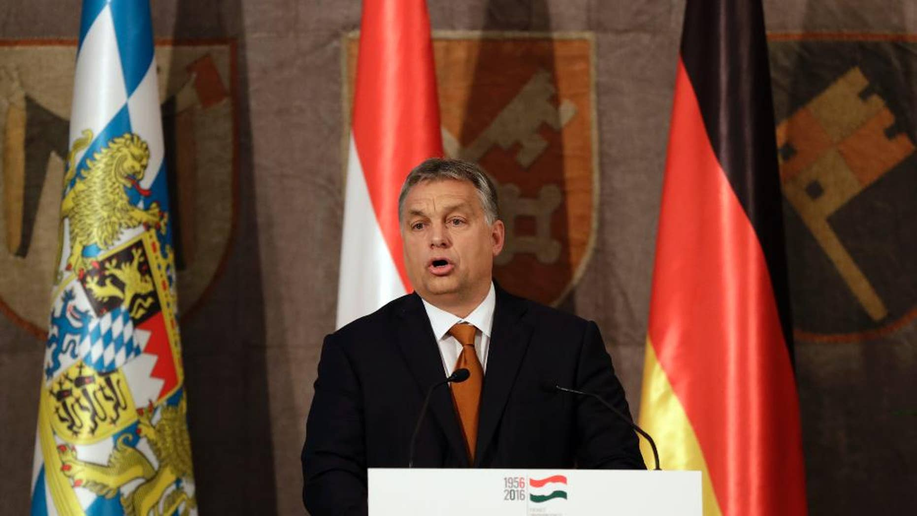 Hungary's Prime Minister Victor Orban stands on the podium during his speech to mark the 60th anniversary of the Hungarian Revolution in Munich, Germany, Monday, Oct. 17, 2016. (AP Photo/Matthias Schrader)
