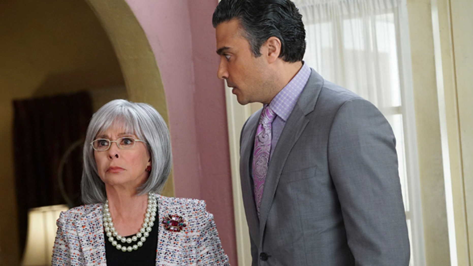 "This photo provided by The CW shows, Rita Moreno, left, as  Liliana, and Jaime Camil as Rogelio, in the episode Chapter Eighteen, of the television series, ""Jane the Virgin. Moreno guest stars on the Monday April 13, 2015 episode playing a difficult grandmother. (AP Photo/The CW, Danny Feld) MANDATORY CREDIT: NO SALES; NO ARCHIVES; NORTH AMERICA USE ONLY."