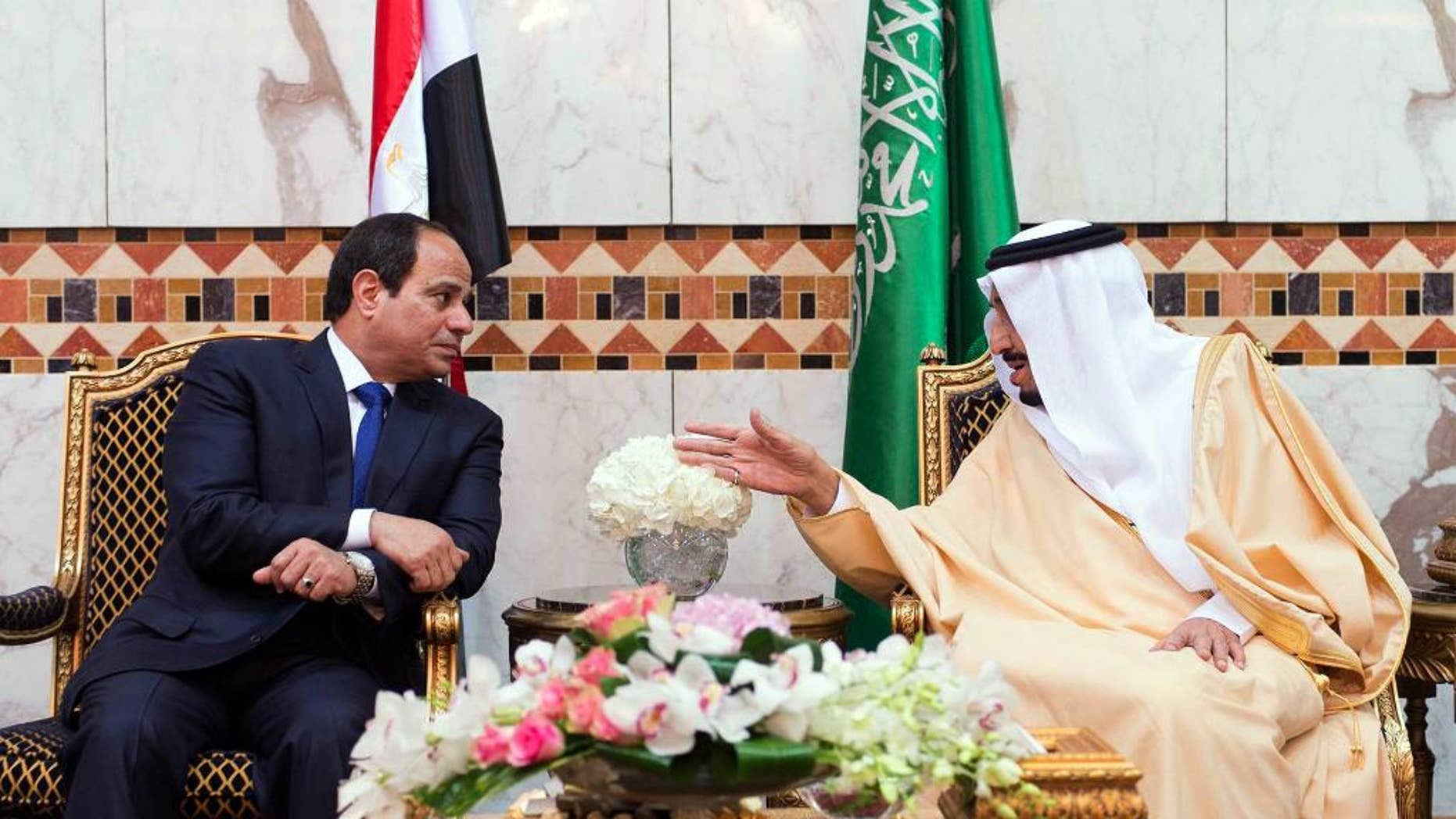 FILE - In this file photo provided by the Saudi Press Agency on March 1, 2015, Saudi King Salman, right, meets with Egyptian President Abdel-Fattah el-Sissi upon his arrival to Riyadh Airbase, Riyadh, Saudi Arabia. Egypt's president says his country remains committed to close relations with its Gulf Arab allies, but will continue to independently pursue its own policies to safeguard Arab security. El-Sissi's comments on Thursday, Oct. 13, 2016 were his first after a diplomatic row erupted this week between Egypt and close ally Saudi Arabia over Syria.(SPA via AP, File)
