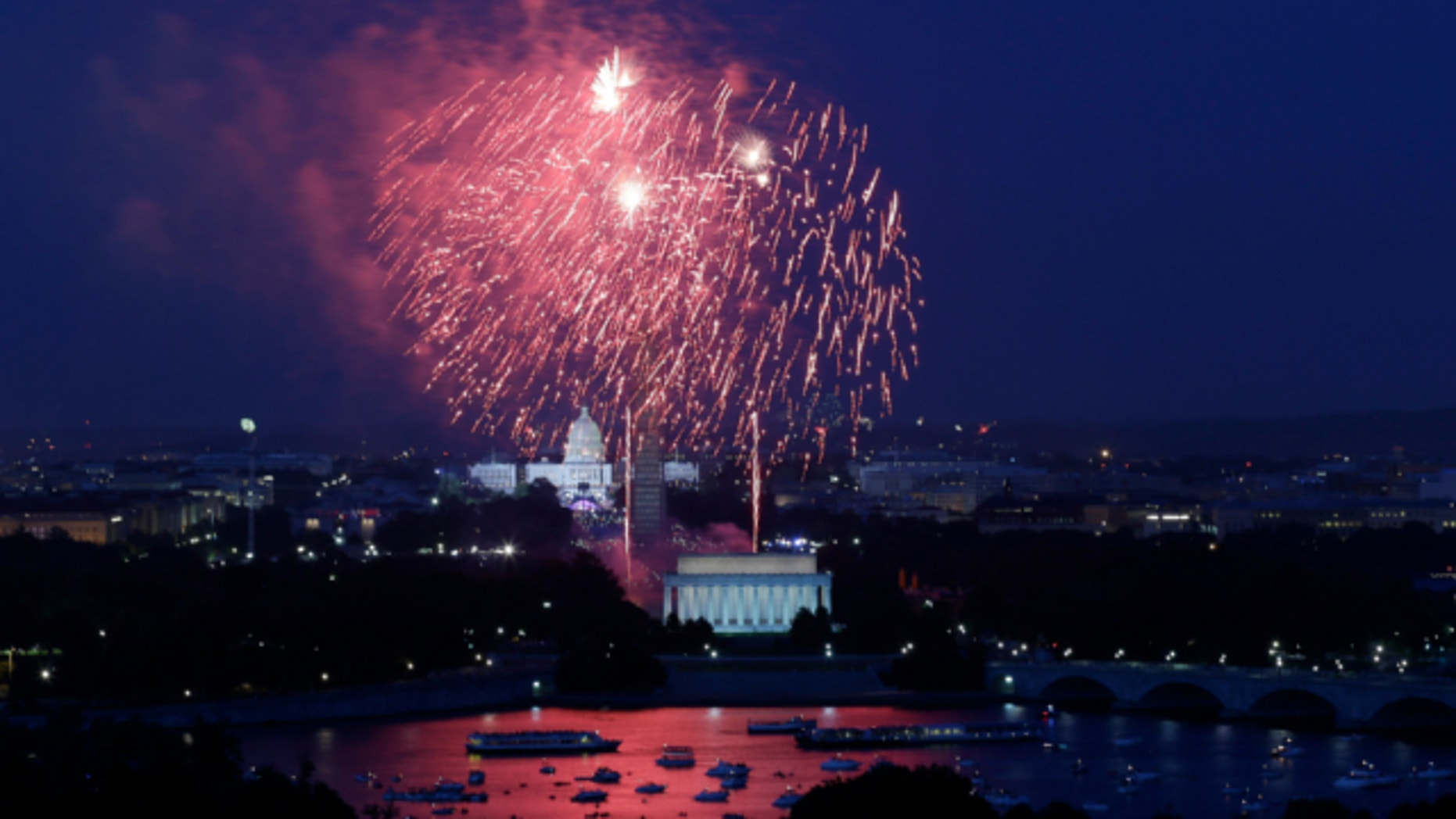 July 4, 2013: Fireworks light the sky over the U.S. Capitol, left, the Washington Monument and the Lincoln Memorial during Fourth of July celebrations in Washington.