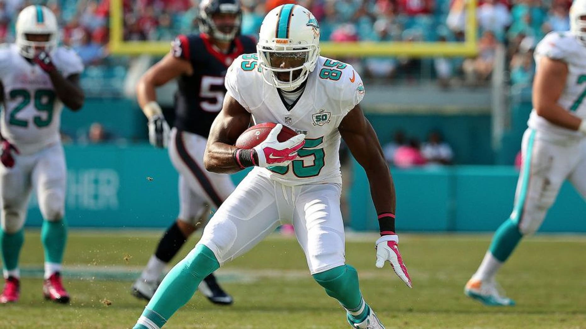 MIAMI GARDENS, FL - OCTOBER 25: Greg Jennings #85 of the Miami Dolphins runs after a catch during a game against the Houston Texans at Sun Life Stadium on October 25, 2015 in Miami Gardens, Florida. (Photo by Mike Ehrmann/Getty Images)