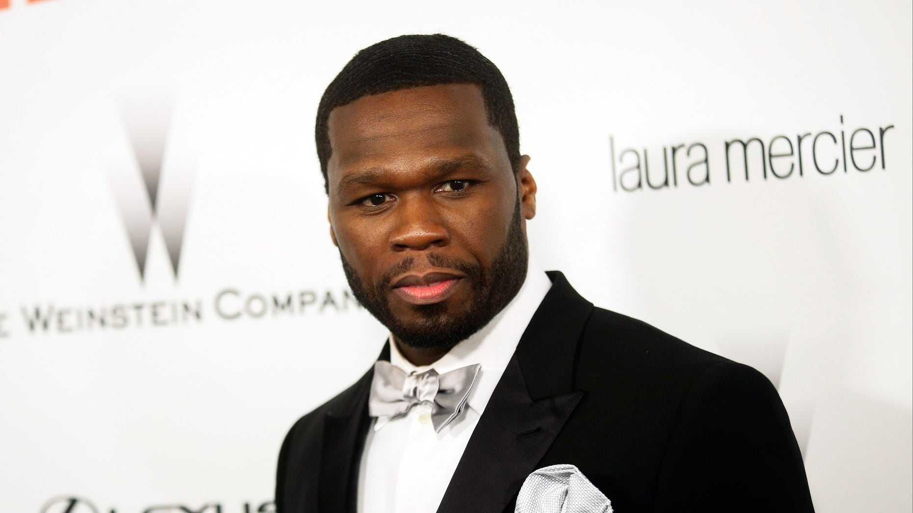 """Actor and musician Curtis """"50 Cent"""" Jackson arrives at the Weinstein Netflix after party after at the 72nd annual Golden Globe Awards in Beverly Hills, California January 11, 2015.  REUTERS/Patrick T. Fallon   (UNITED STATES - Tags: ENTERTAINMENT) (GOLDENGLOBES-PARTIES) - RTR4L1ET"""