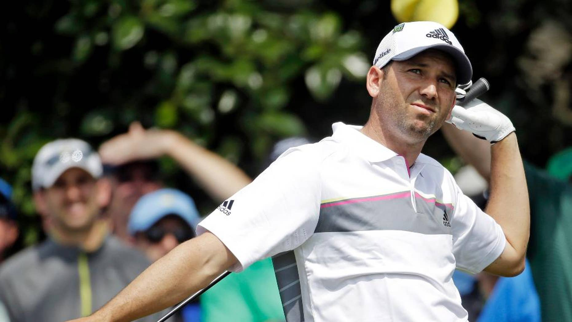Sergio Garcia, of Spain, watches his tee shot on the ninth hole during the second round of the Masters golf tournament Friday, April 11, 2014, in Augusta, Ga. (AP Photo/Darron Cummings)