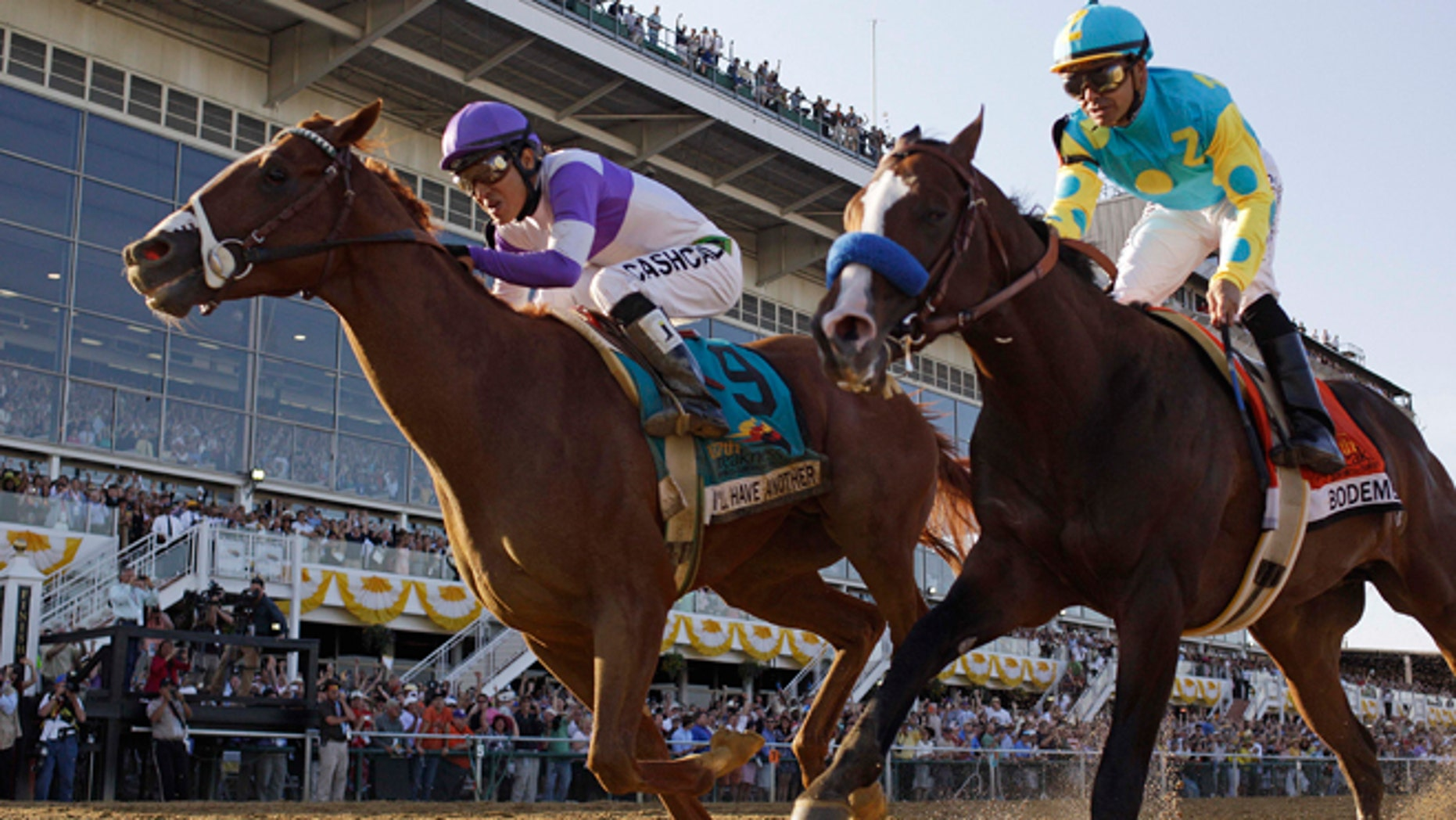 I'll Have Another (9), ridden by Mario Gutierrez, beats Bodemeister, ridden by Mike Smith, to the finish line to win the 137th Preakness Stakes horse race at Pimlico Race Course, Saturday, May 19, 2012, in Baltimore.(AP Photo/Matt Slocum)