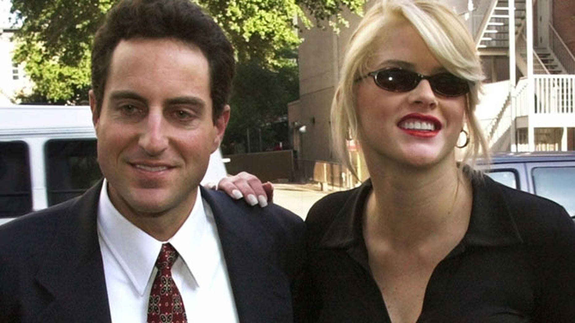 In this Oct. 2, 2000 file photo, Anna Nicole Smith, right, smiles as she walks to the courthouse with her attorney Howard K. Stern in Houston. Attorneys in the Anna Nicole  Smith drug conspiracy trial are set with final arguments aimed at swaying jurors in reaching a complicated and crucial set of verdicts that will affect two doctors and the deceased model's former boyfriend.