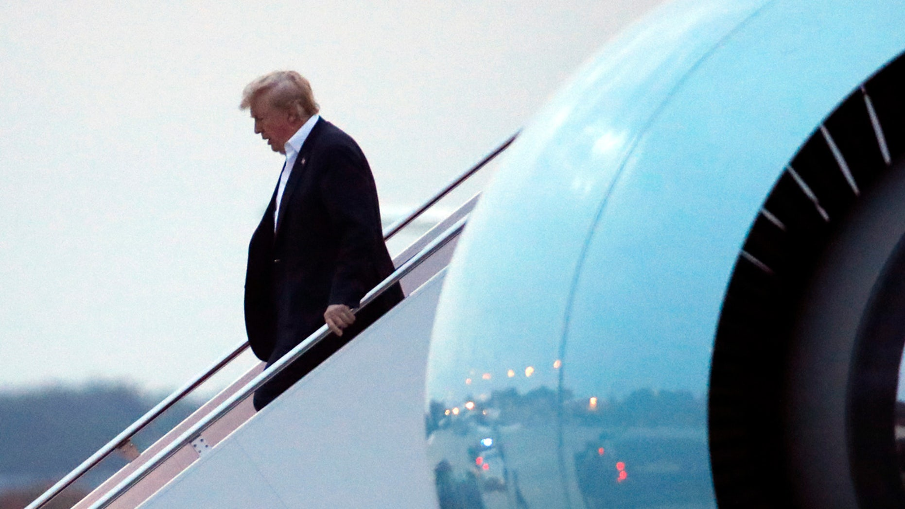 June 13:  President Trump steps off Air Force One as he arrived at Andrews Air Force Base. Trump returned from Singapore and a meeting with North Korean leader Kim Jong Un.