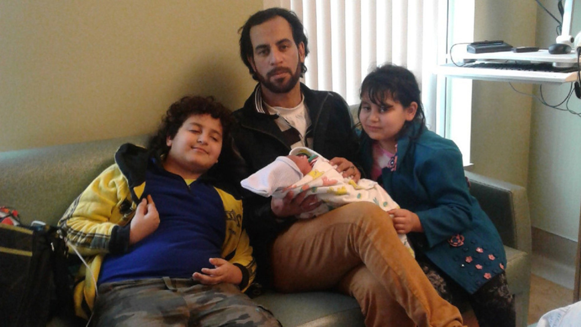 Zarif Kelada, center, was put on life support after suffering a heart attack when he confronted two teen robbers.