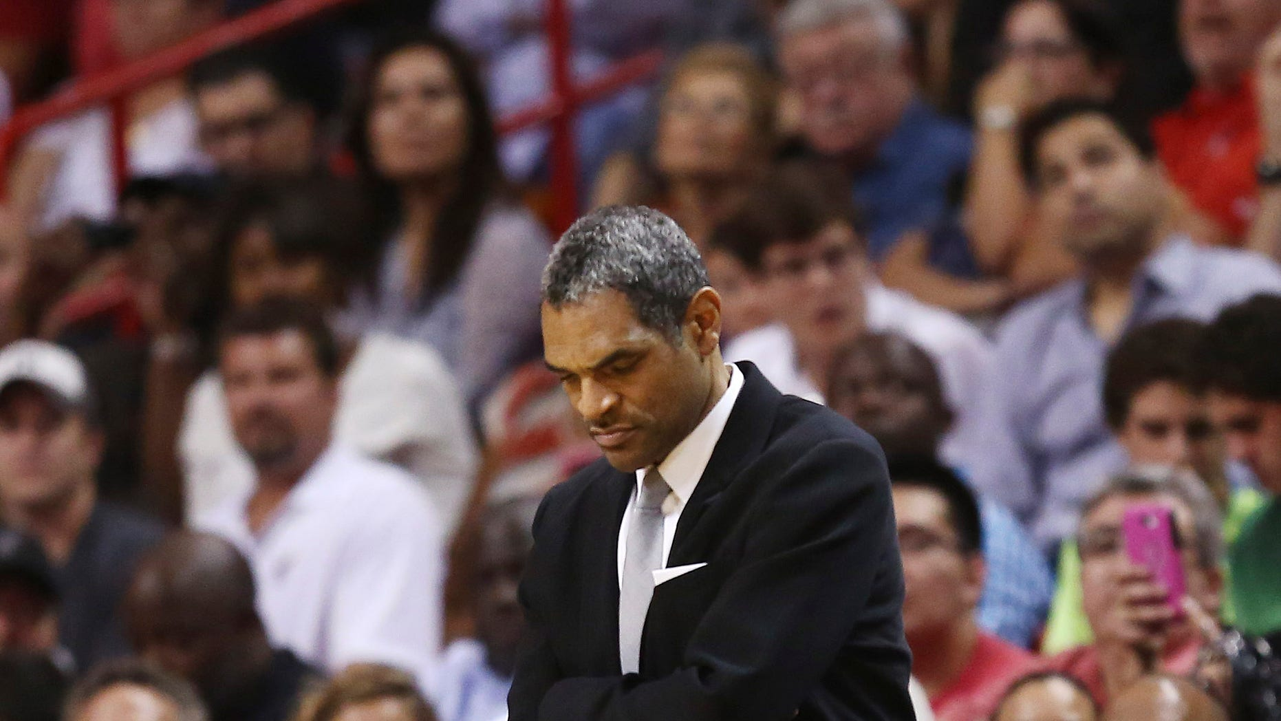 Detroit Pistons head coach Maurice Cheeks watches game action against the Miami Heat during the second half of an NBA basketball game in Miami, Monday, Feb. 3, 2014. The Heat won 102-96. (AP Photo/J Pat Carter)