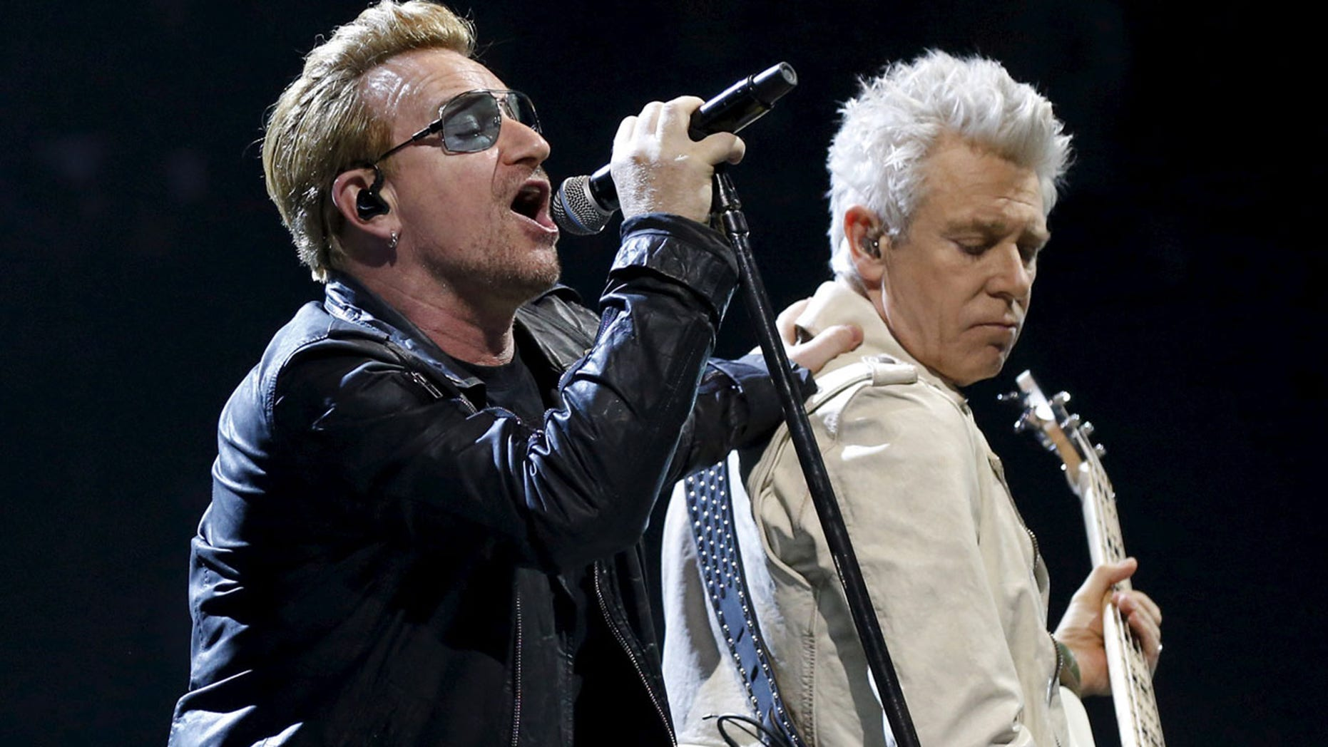FILE 2015: Bono and Adam Clayton of Irish band U2 perform during their concert at the AccorHotels Arena in Paris.