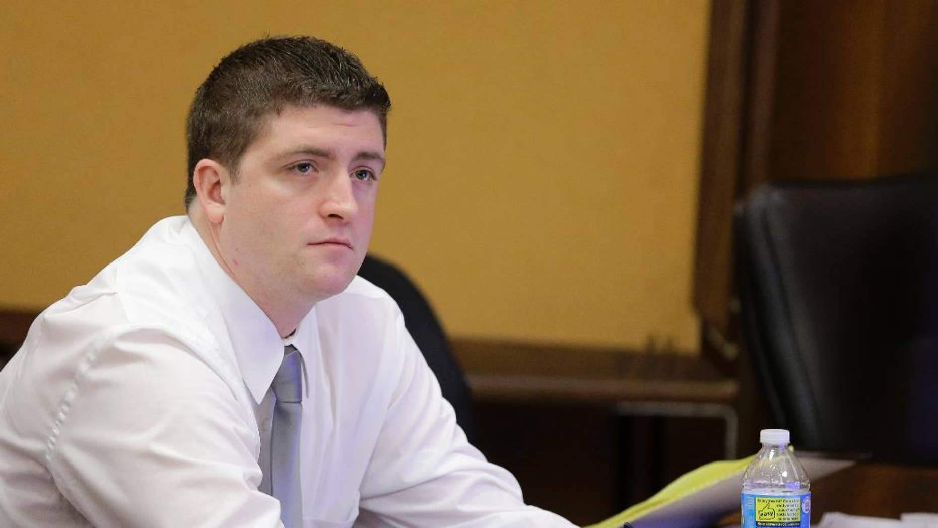 Cleveland police officer Michael Brelo listens to testimony during his trial Thursday, April 9, 2015, in Cleveland. Brelo is being tried on two counts of voluntary manslaughter in the November 2012 deaths of Timothy Russell, 43, and Malissa Williams, 30, after a high-speed chase. (AP Photo/Tony Dejak, Pool)