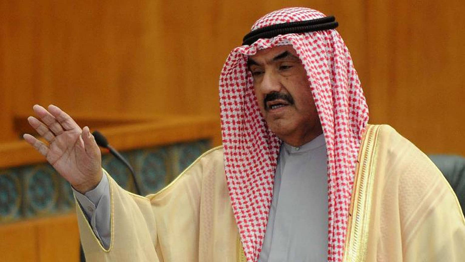 Kuwaiti politician Sheikh Nasser al-Mohammad al-Sabah arrives at the parliament building in Kuwait City, on June 8, 2011
