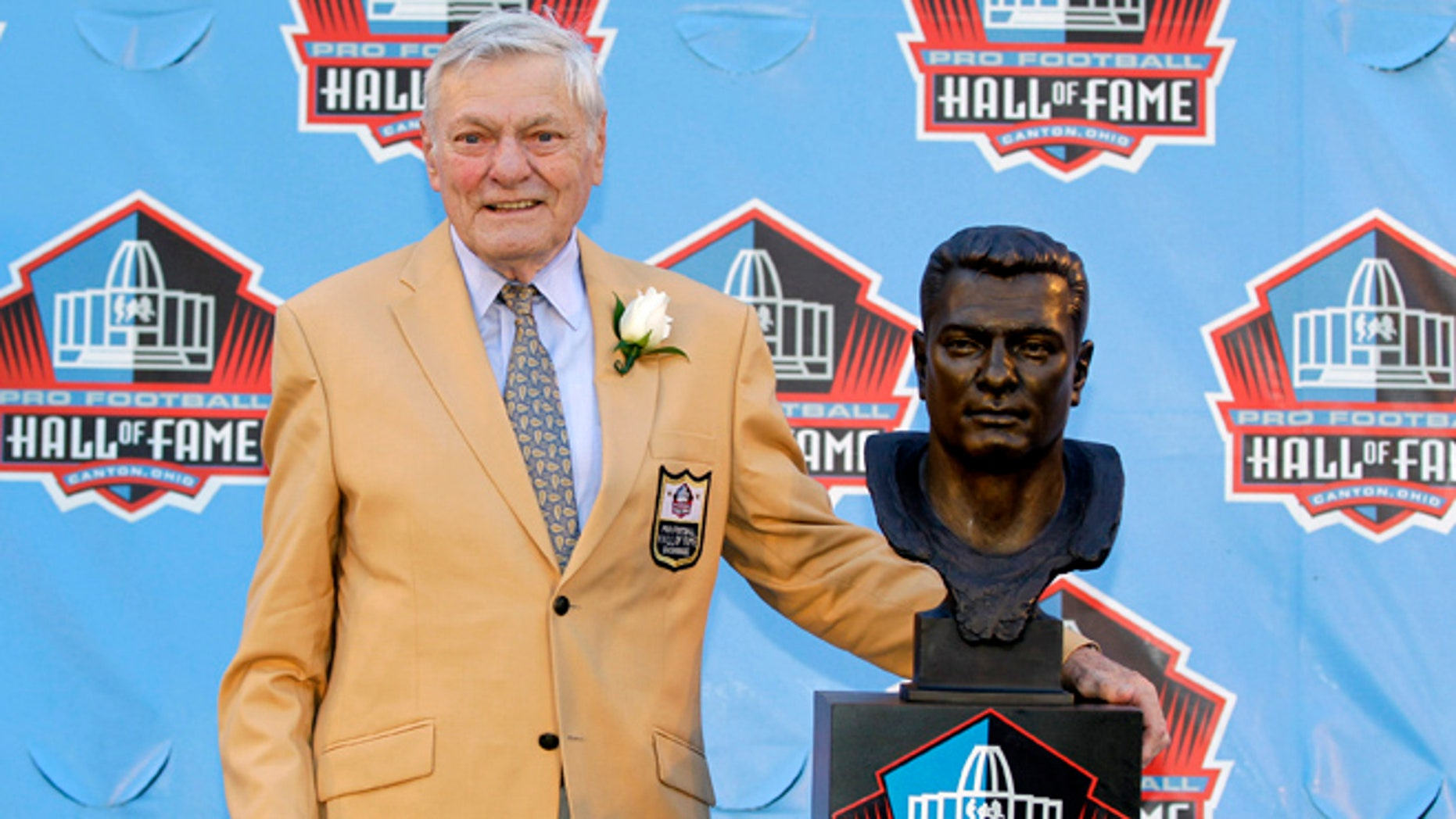 FILE- Int is Aug. 4, 2012, file photo, former NFL football player Jack Butler poses with a bust of himself during an induction ceremony at the Pro Football Hall of Fame in Canton, Ohio. Butler died Saturday morning, may 11, 2013, following a lengthy battle with a staph infection, his son John Butler said. He was 85. (AP Photo/Gene J. Puskar, File)