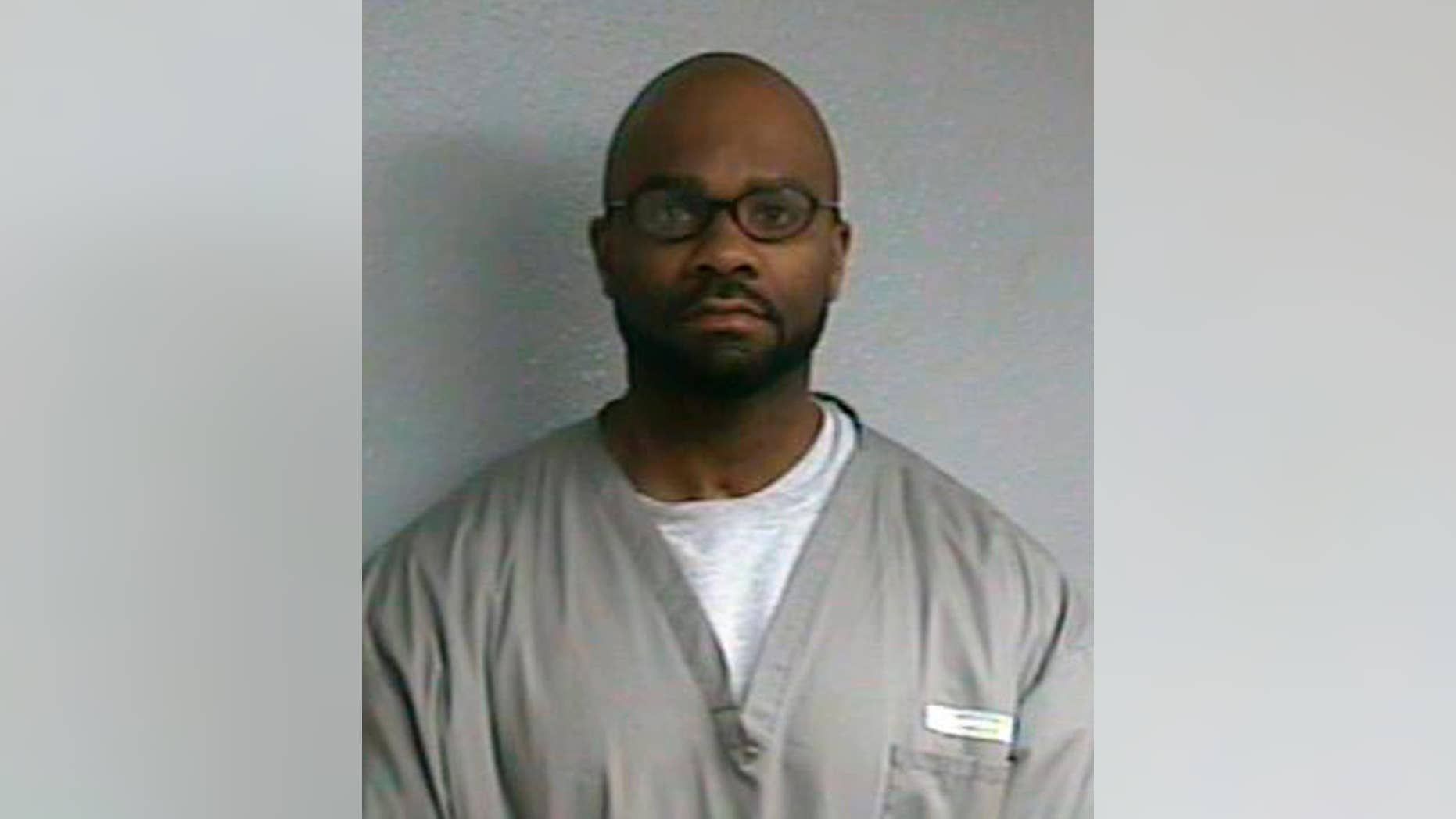 FILE- This March 6, 2015, file photo provided by the Oklahoma Department of Corrections shows Demarco Carpenter, also known as Demarchoe Carpenter. An Oklahoma judge on Monday, May 9, 2016, has declared that Carpenter and another men who were convicted in the drive-by shooting death of a woman 22 years ago are innocent and vacated their convictions. (Oklahoma Department of Corrections via AP, File)