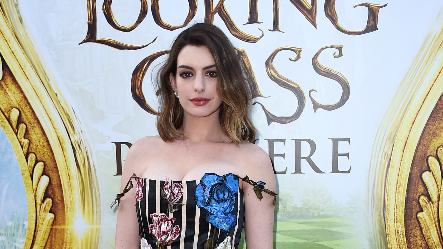 "It's hard to believe Anne Hathaway recently gave birth to a son! The new mom donned an ""Alice in Wonderland"" inspired look for the LA premiere of ""Alice Through the Looking Glass."""