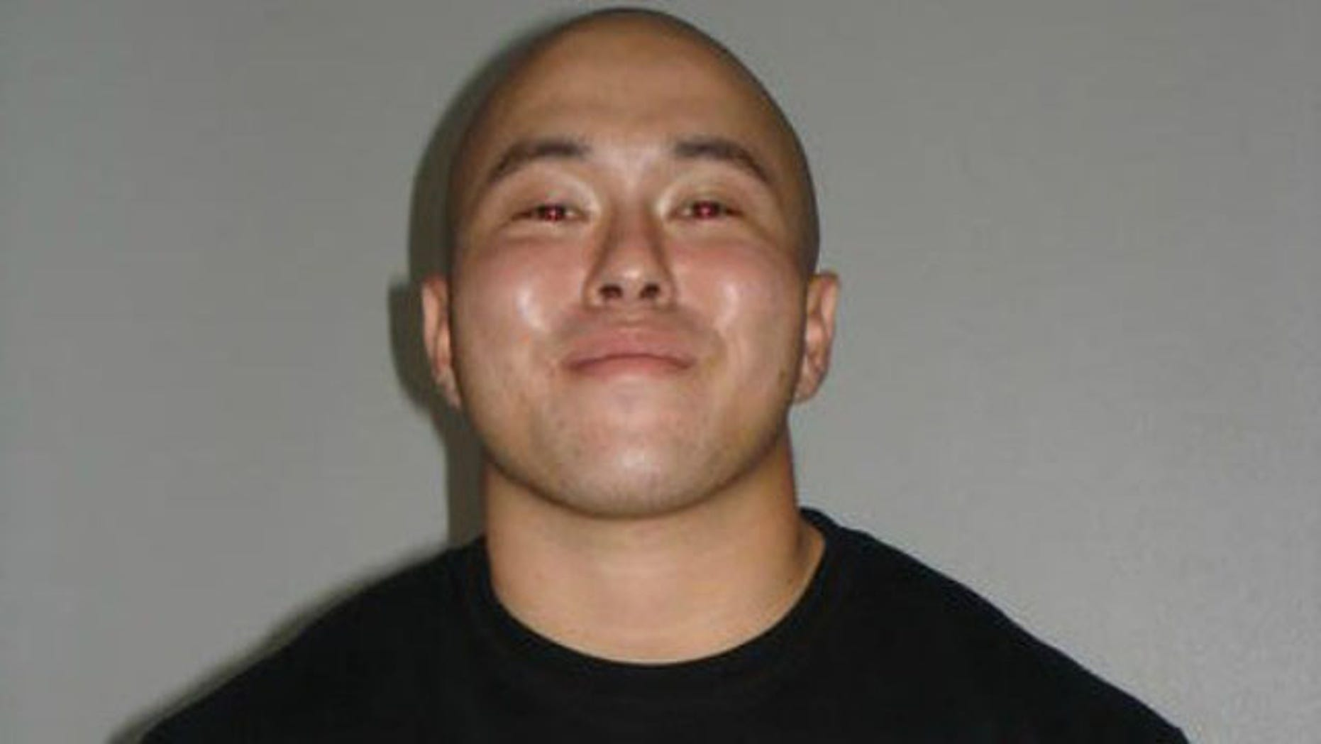 October 14, 2014: This photo shows Michael Tanouye, who was arrested and accused of sexually assaulting a woman in the bathroom of a flight from Hawaii to Japan. (FBI)